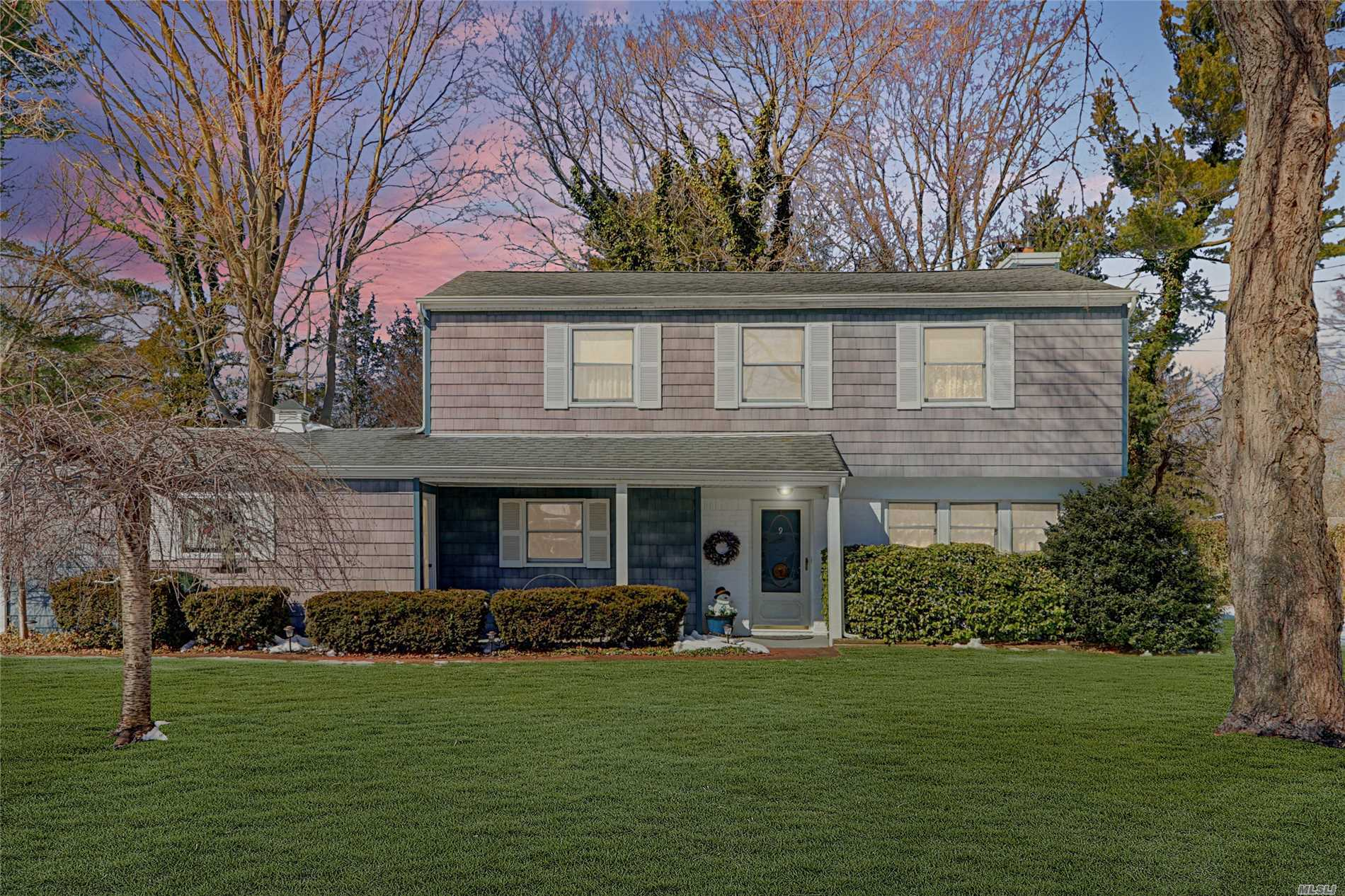 Harborfields Schools! 4 Bed/1.5 Bath Split Style Colonial, Bright & Open Family Room with Vaulted Ceilings and Fireplace Overlooking Shy Manicured 1/2 Acre, Gas Heating, Wood Floors. NEWER: Boiler & Hot Water Heater, Cesspool, Appliances. Quiet Mid-Block Location.