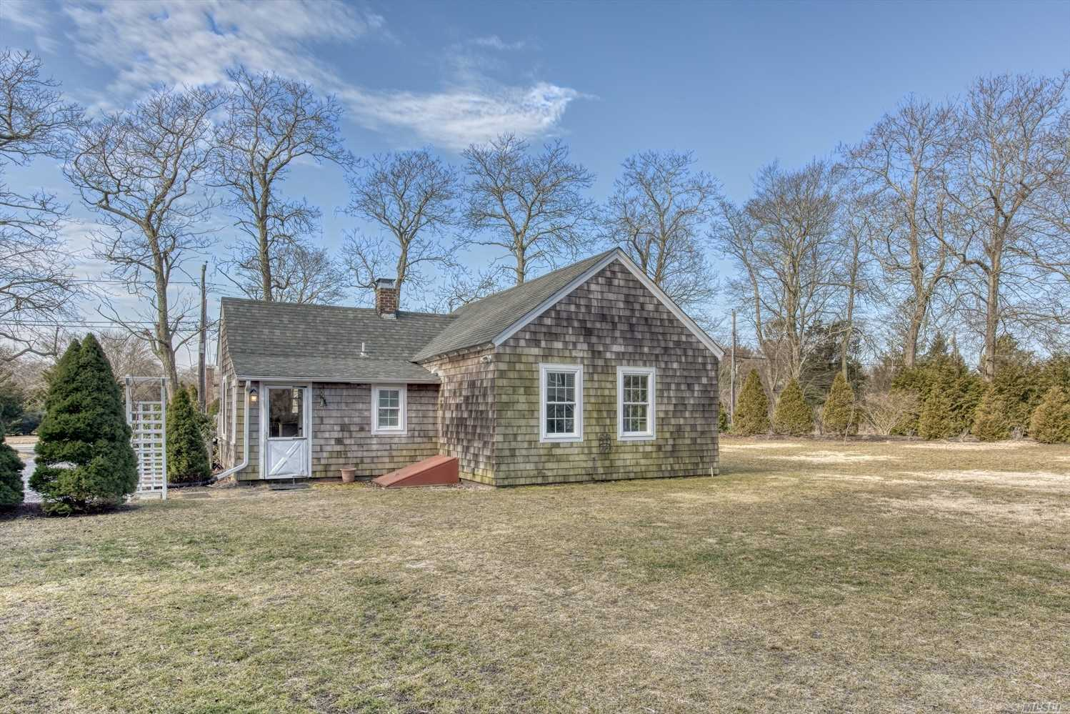 Exciting opportunity for an investor , business owner , artist studio or resident in the charming hamlet of East Quogue. Historic cottage recently renovated throughout has room to expand and room for a pool. seperate 6 car garage and office space .