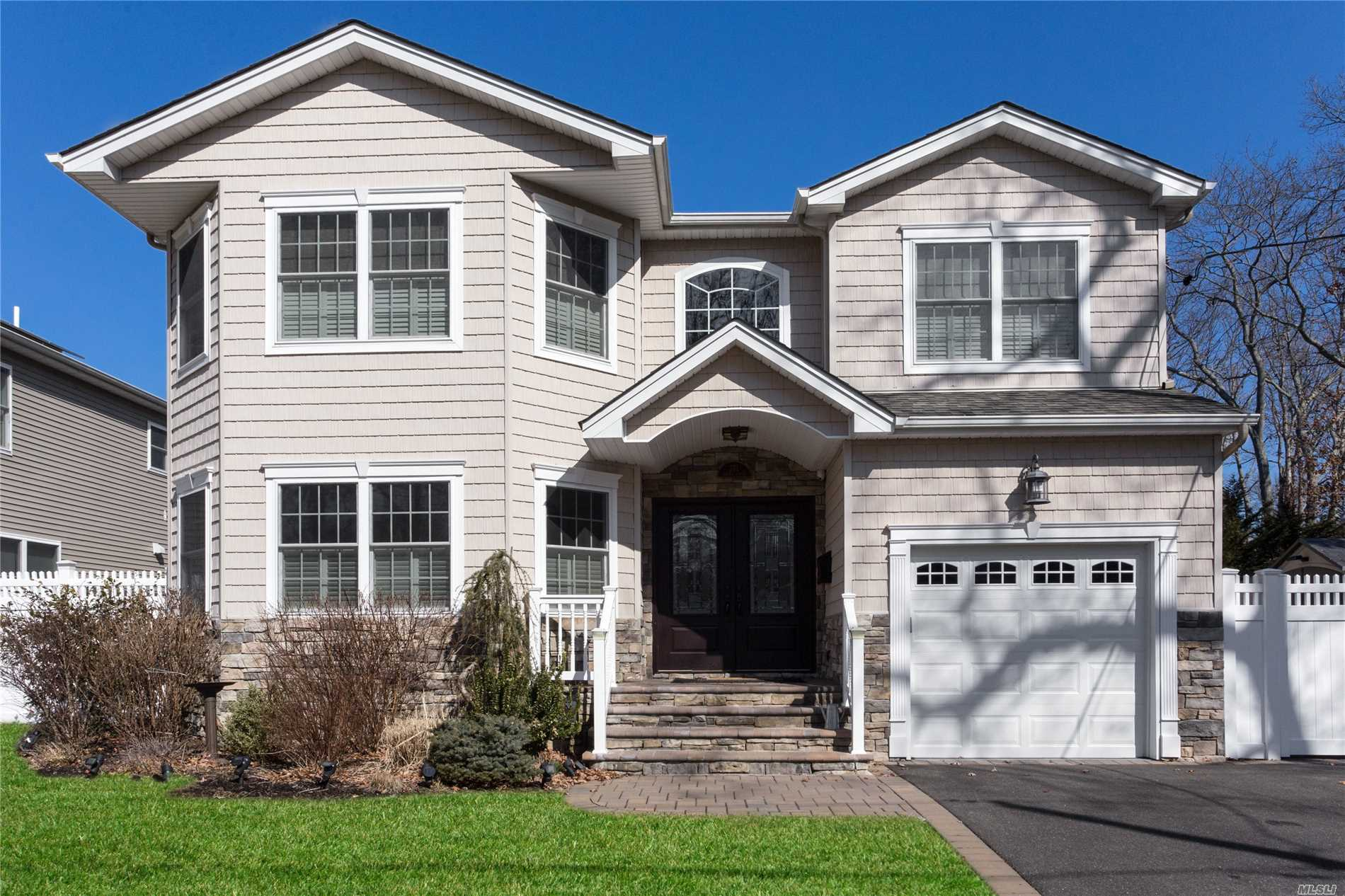 Better than new! 2014 4 bedroom, 2.5 bath stunning side hall Colonial with many upgrades located in Parkside Estates. Outdoor kitchen, hardscape lighting, premium granite and tile, Plantation shutters,  too much to list. Tax grievance filed. A MUST SEE!