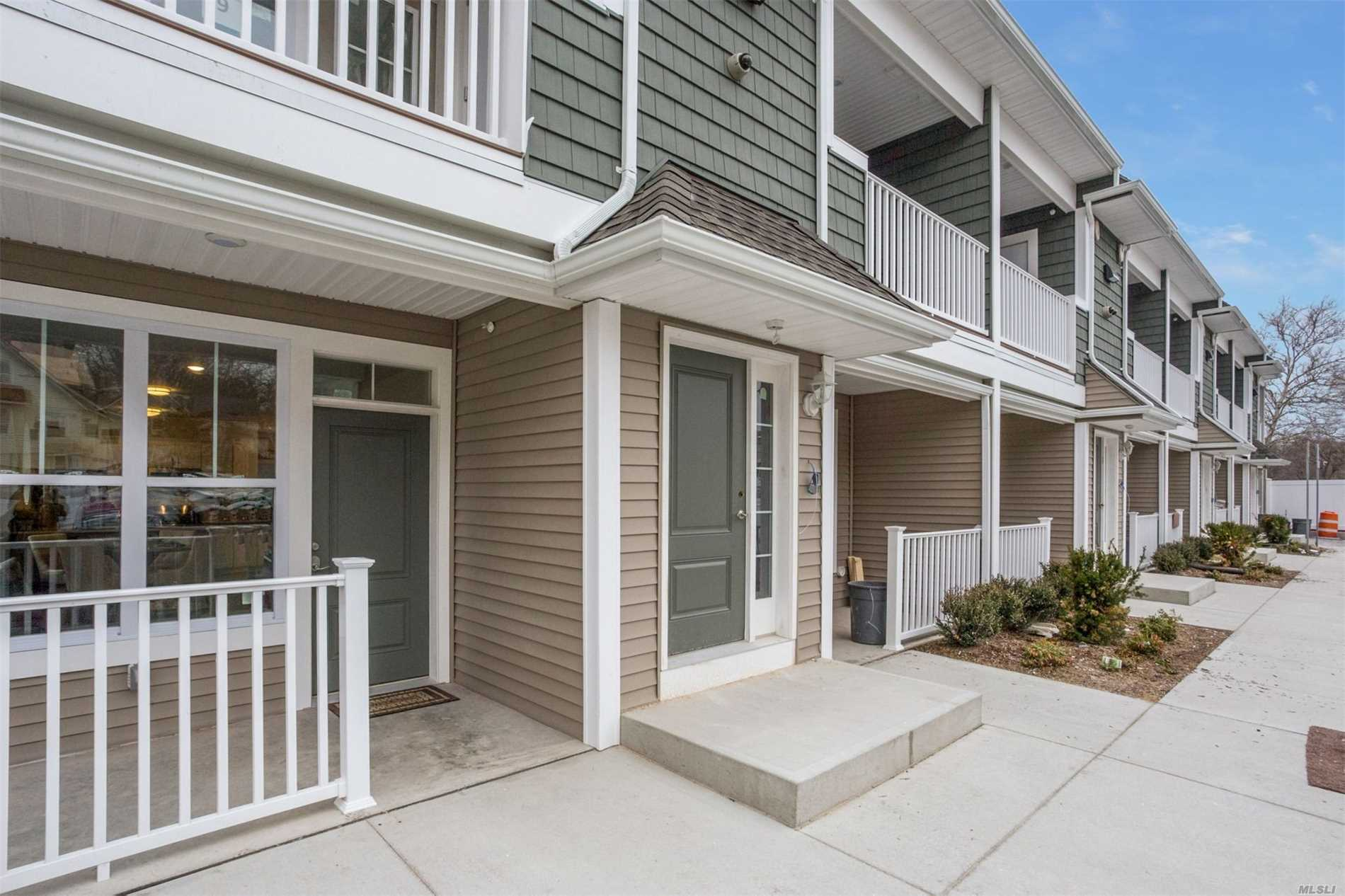 New Spacious One Bedroom Apartments. Designer Eik W/Ss Appliances -Gas Cooking. Wood Design Flooring, Large Closets, CAC, Washer/Dryer, Balcony Or Private Porch Per Unit. Conveniently Located. A Must See!