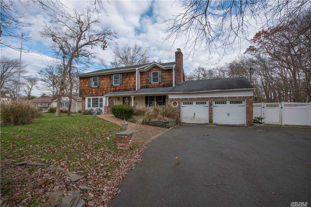 True Center Hall Colonial 4 Bedroom, 2.5 Baths, Hardwood Floors, Wood Fireplace, All Large Rooms. Gorgeous Backyard, Great For Entertaining. Semi- In ground Pool Surrounded By A Hugh Deck And Private Backyard.