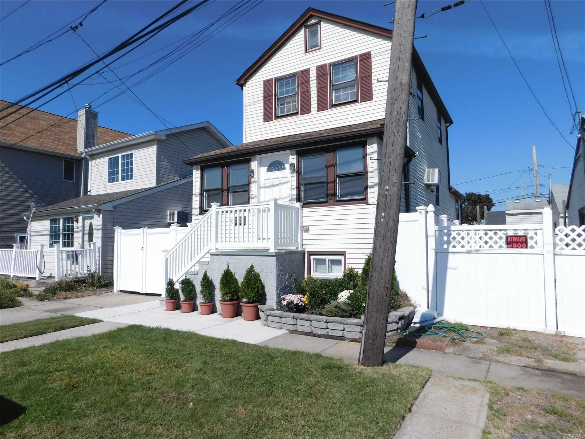 Renovated Colonial W/ Large Private Yard In Beautiful E. Rockaway! House Features Newer Kitchen W/ Ss Appls. New Bathroom, High Ceilings W/ Lots Of Natural Sunlight, 5 Year Old Gas Heat Syst/1-Layer Roof/Electric/ Ac's, Igs, New Pvc Fence, Prof Landscaped, 2 Attics For Storage, Full Fin-Basement W/Co & Ose. Only $8317 Taxes With Star! No Village Taxes. Overnight Street Parking!