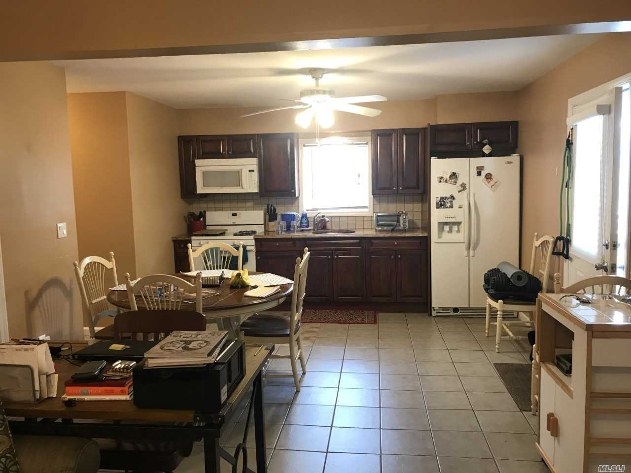 Spacious & clean first floor apartment. Open Floor plan with updated kitchen, dining area and living room. Large bedroom and Full bath with tub. Parking for one car only. Includes heat and water. Electric is seperate. No Pets, No smoking! Landlord occupied property.