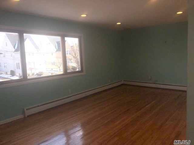 This Beautiful Bright and Sunny Renovated 2 Bedroom Apartment COMES WITH Washer And Dryer. SPACIOUS bedrooms and lots of closets. Parking Space Available for 1 possibly 2 cars. Steps Away From The LIRR,  Great For People Commuting To The City.