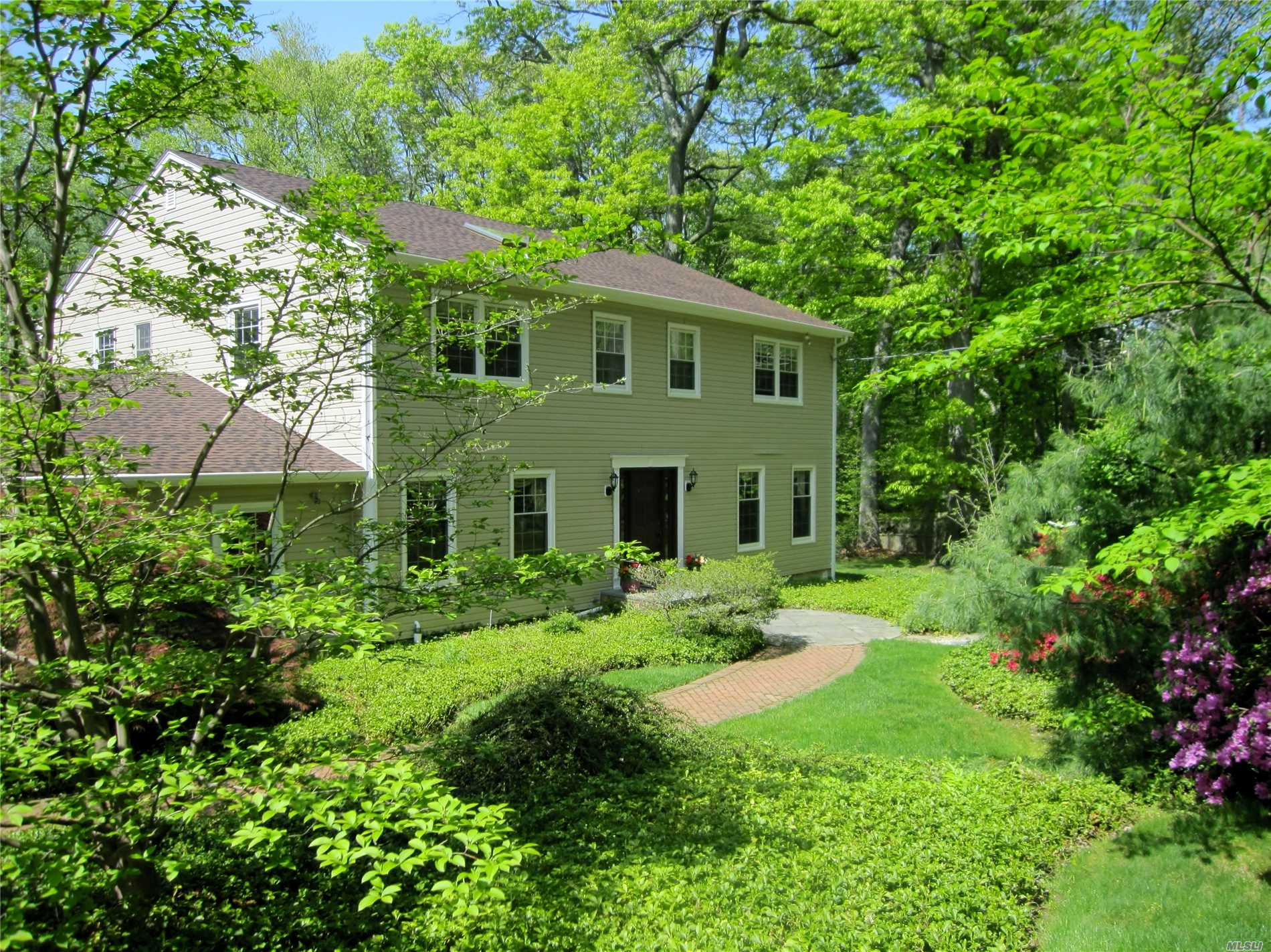 Classic Center Hall Colonial with spacious rooms and ideal flow for large-scale entertaining. In cul-de-sac location and backing a nature preserve, this lovely home features many recent updates and offers a first floor bedroom suite with a private entrance. Formal Dining Room with elegant built-ins, Den with fireplace and bright eat-in-kitchen that opens to Large deck overlooking heated pool. Gorgeous property with low taxes complete this wonderful offering!