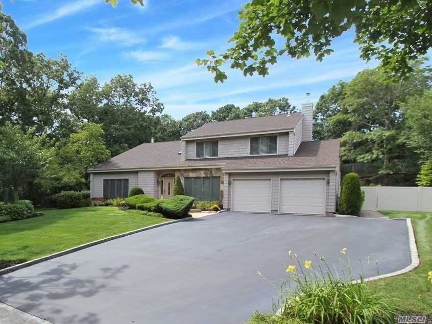 Largest Estate Model Nestled On An Amazing Pvt.Country Club Yard Shy Half Acre Property w/Heated Inground Pool In The Sought After Country Woods Dev. This Diamond Home Boasts Hardwood Flooring Under Carpets In Some Rms, Bright Open Floor Plan, Vaulted Ceilings, Large Granite Eat In Kitch., Center Island, SS App., Butlers Pantry, Large Master Suite, Deluxe Baths, Anderson Windows & Sliders,  Arch.Roof, Fence, Maint. Free Impressed Siding, Deck, NG-Generator, Paver Patio And More!