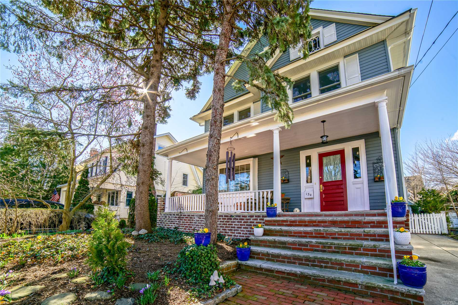 An ideal location & great curb appeal make this Queen Anne style home very desirable. There is nothing like sitting on your own front porch w/family, friends &neighbors.Updated eat in country kitchen, large lr w/fp & dr open to a rear deck & beautiful garden space. Many windows have been replaced, powder room is located on this 1st flr.Second story has 4 brs & updated bth. 3rd story walk up attic is a large, bright area w/4 skylights & a wonderful, bright bonus area.Basement has new windows/laundry