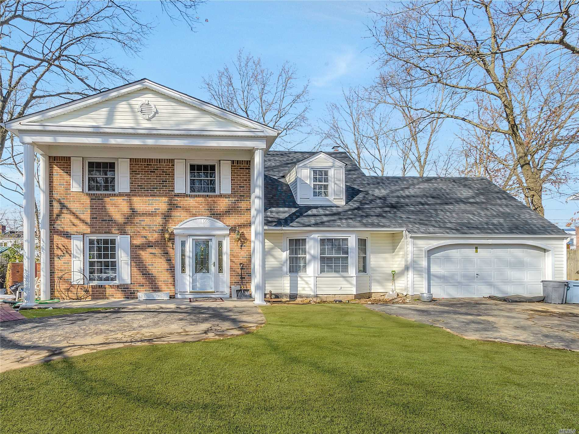 Fabulous 9 Room Colonial in Birchwood! This home features oak floors, ceramic kitchen and baths, brick fplce,  new hall bath, mostly updated windows, new roof and cesspool - duct work is in for CAC. Family Room and kitchen access Country Club yard saltwater pool - new liner and custom loop lock cover. Don't Delay!
