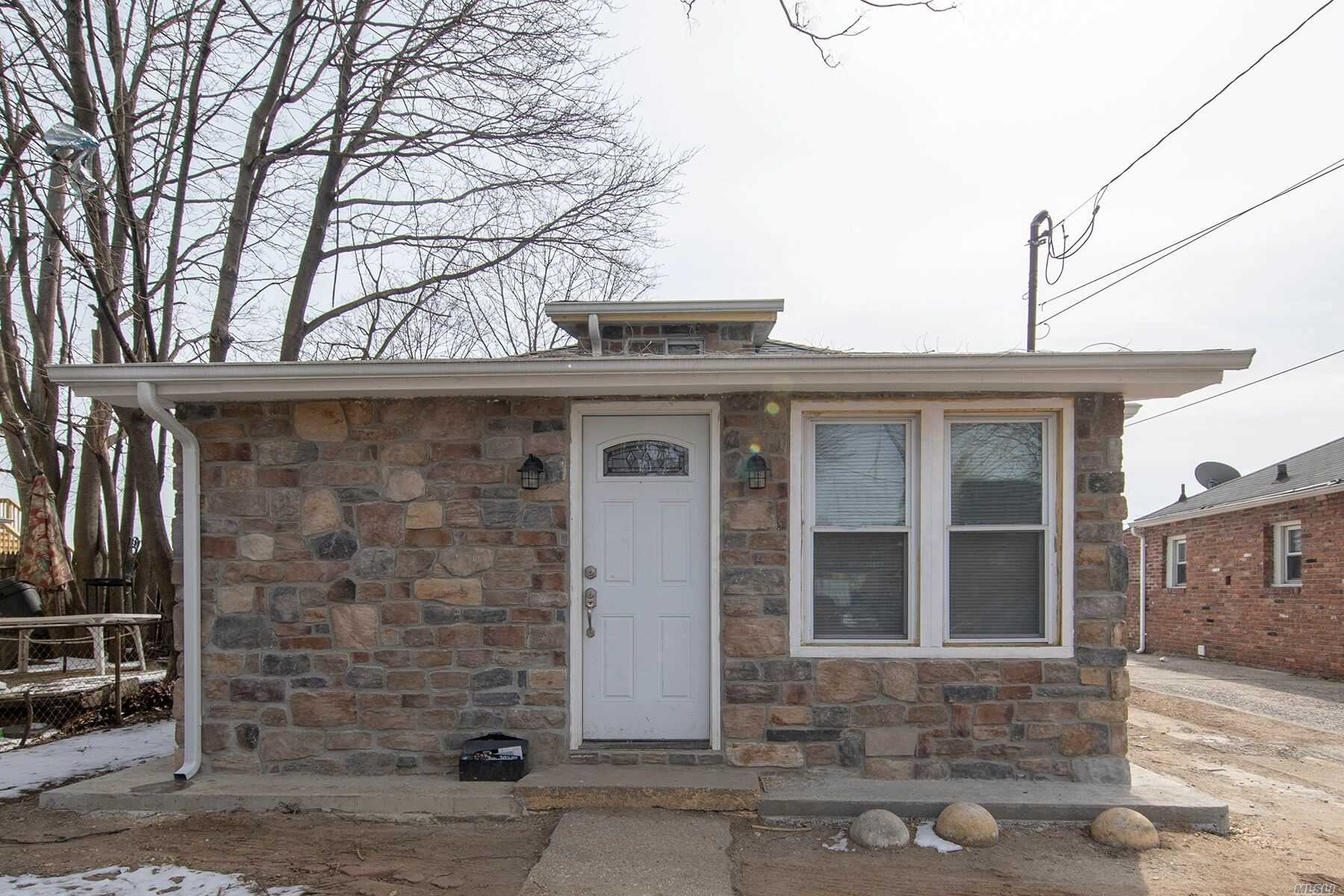 Gorgeous Bungalow in Hempstead Featuring 3 Bedrooms, 2 Bath , Nice Kitchen With Stainless steel Appliances , New Bathrooms, New roof , New Siding , New Electric, High Hats Thoroughout the house, New Doors , Laminate Floors , 15-20 mins to Queens and JFK. Must see!!