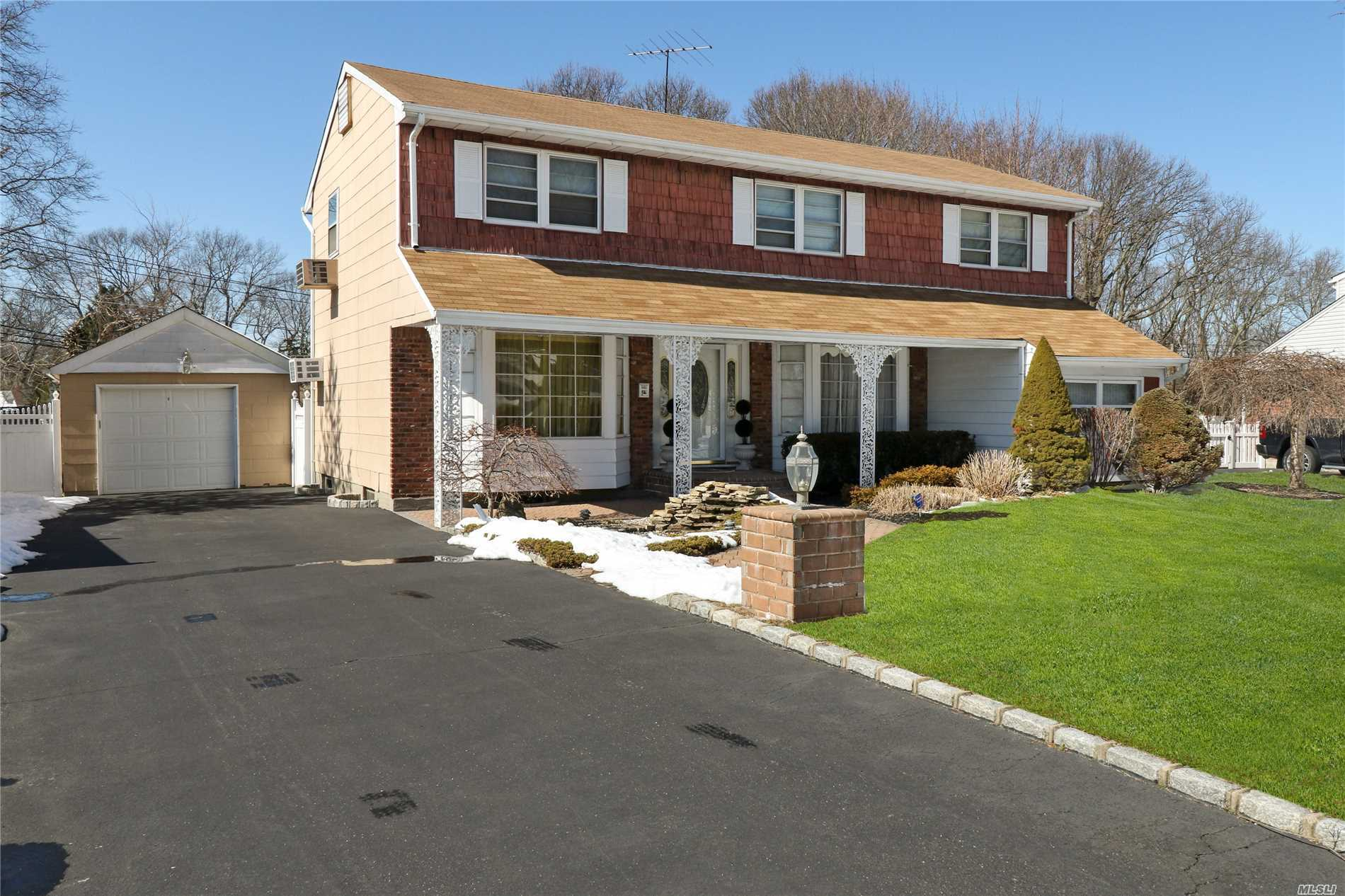 Spacious and wonderful 4 bed Center Hall Colonial set on .28 acre of pristine property. All hardwood floors throughout. Updated kitchen/some newer windows/tons of closet space/new doors throughout/Gas lines in font of house/PVC fence around entire property/travertine patio/ koi pond/Ideal location all within the famed Commack Blue Ribbon school district. Basic star is $1, 202.97.