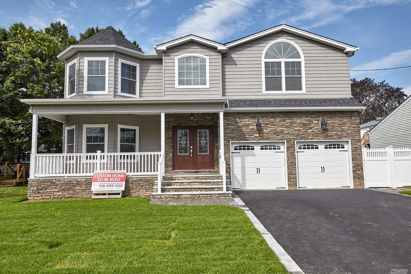 Brand new custom colonial. Act now to customize to your own design! 3600 square feet of open floor plan plus a full basement, cellar entrance, and porch. Designed and finished with expert help from the builder throughout the process. Amenities include: custom kitchen and bathroom vanities, Pella windows, intricate trim work and wainscotting, 2.5 baths, 2nd floor laundry room with sink, and master suite with two walk in closets and whirlpool tub in master bath.