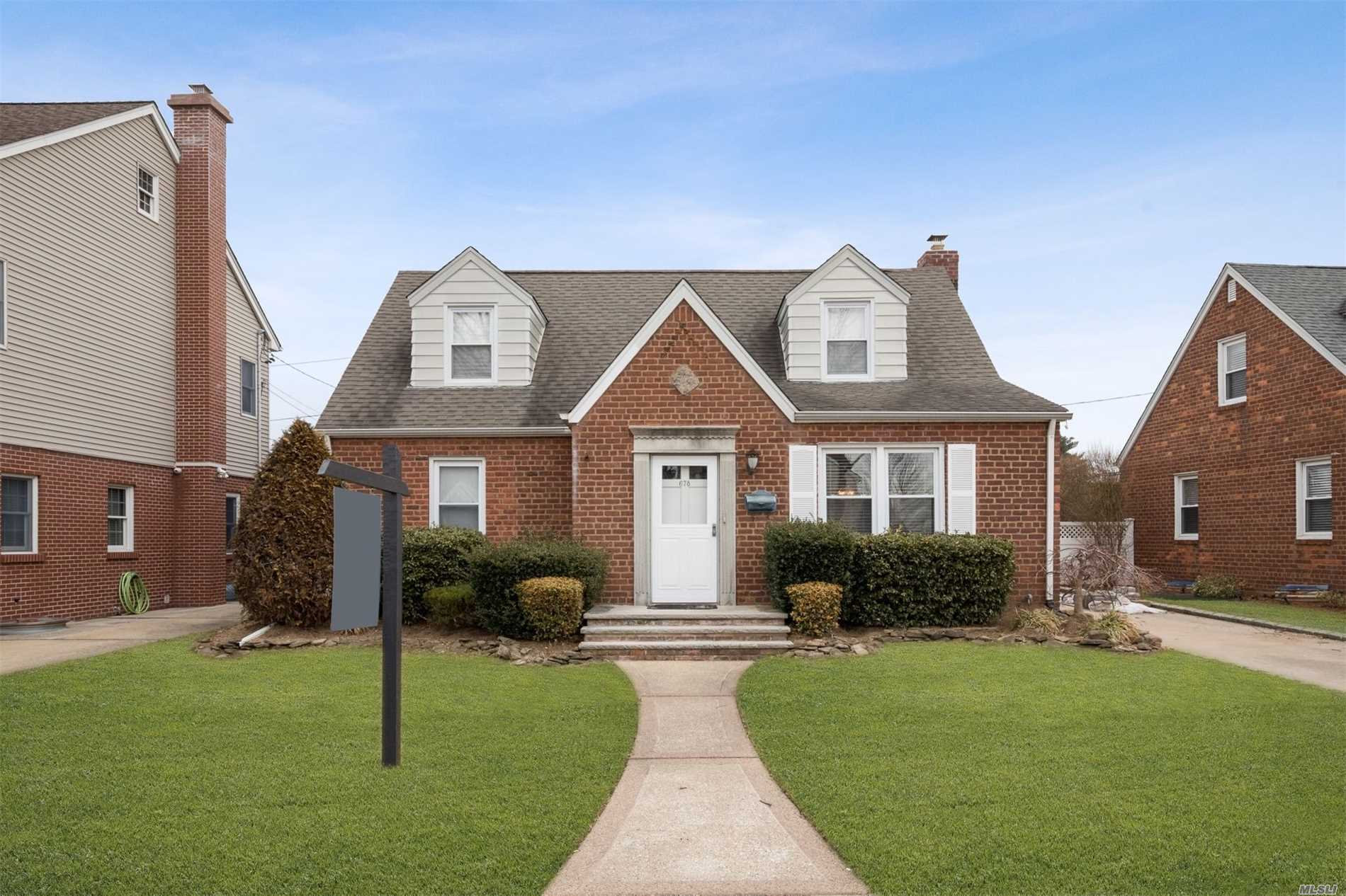 Welcome Home To This Expanded Brick Cape, Close To All, Public Transportation, Shopping, Shelter Rock Public Library, Herricks School District & Much More, New Finished Basement, Hardwood Floors, Large Bedrooms, Many Updates Throughout The Home, Hurry And Don't Miss Out On This One--Will Not Last!!