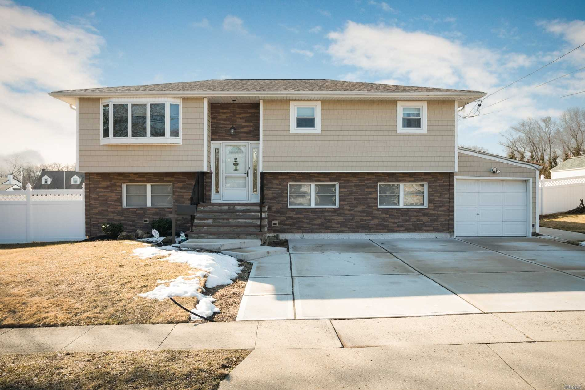 Diamond Hi Ranch * Updated w/4 Seasons Sun room, Covered Patio Under Sun room, Deck, In ground Pool (16x36 + 10x10) w/Heater Hookup, New Driveway, New Porch, Shed w/Electric, Dead End Block, * Low Taxes, Possible M/D with Proper Permits.Great wide block. 3 Block walk to Super Market and CVS. Near SS Pkwy and 135 (So. Oyster Bay Expressway), Minutes from the town of Farmingdale, with all it's shops and restaurants as well as the Train Station. Also minutes from the Massapequa Train Station.