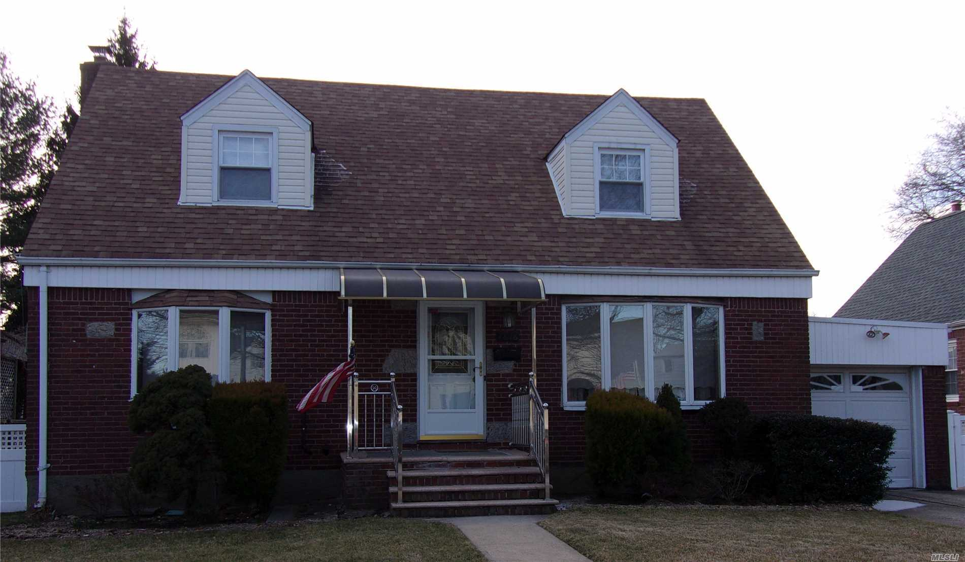 Lovely , Well Maintained , Wide Line Cape In Floral Park. 60X100 Property With Attached Garage And Private Driveway. Desireable Location, Close To Transportation, Shopping And Hospitals. Hardwood Floors Throughout, Oil Heat, Gas Stove. 2 Zone Heating, In Ground Sprinklers, Sd #26.