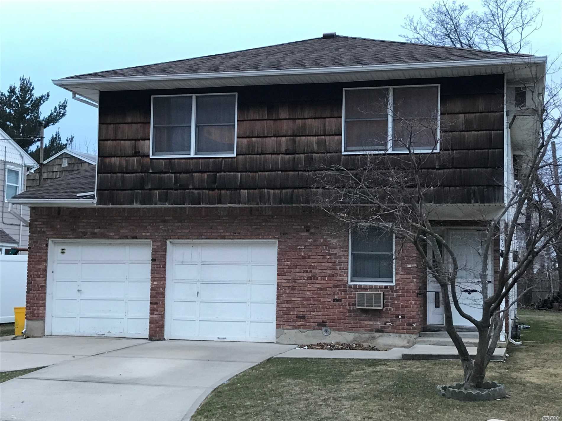 Come see the lights on Broadway. This 5 bedroom, 3 bath home located in the heart of Hewlett, is near train, schools and town. Live in your income producing property and enjoy the large backyard in the beautiful upcoming months. There is a large 2 car garage and private driveways. This home won't last.