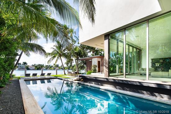 Rene Gonzalez Architectural Masterpiece Completed January 2019 On The Venetian Islands With Dramatic Westerly Sunset Views. Stunning Tropical Modern Five Bed, Five 1/2 Bath Home With Tranquil Open Bay Views Of Biscayne Bay. Book Match Marble Flooring Throughout Ground Floor Living Areas, Custom Carrera Stone In Bathrooms, Open Plan Family And Dining, Artistic Stairway To Second Floor With Custom Oak Flooring, Fleetwood Telescopic Doors Provide Indoor/Outdoor Lifestyle. Spacious Rear Yard With Poolside Bbq, Scenic Roof Top Deck, And Double Car Garage With High Ceilings For Two Additional Cars On Lifts. Short Walking Distance To Sunset Harbor Retail And Restaurants.