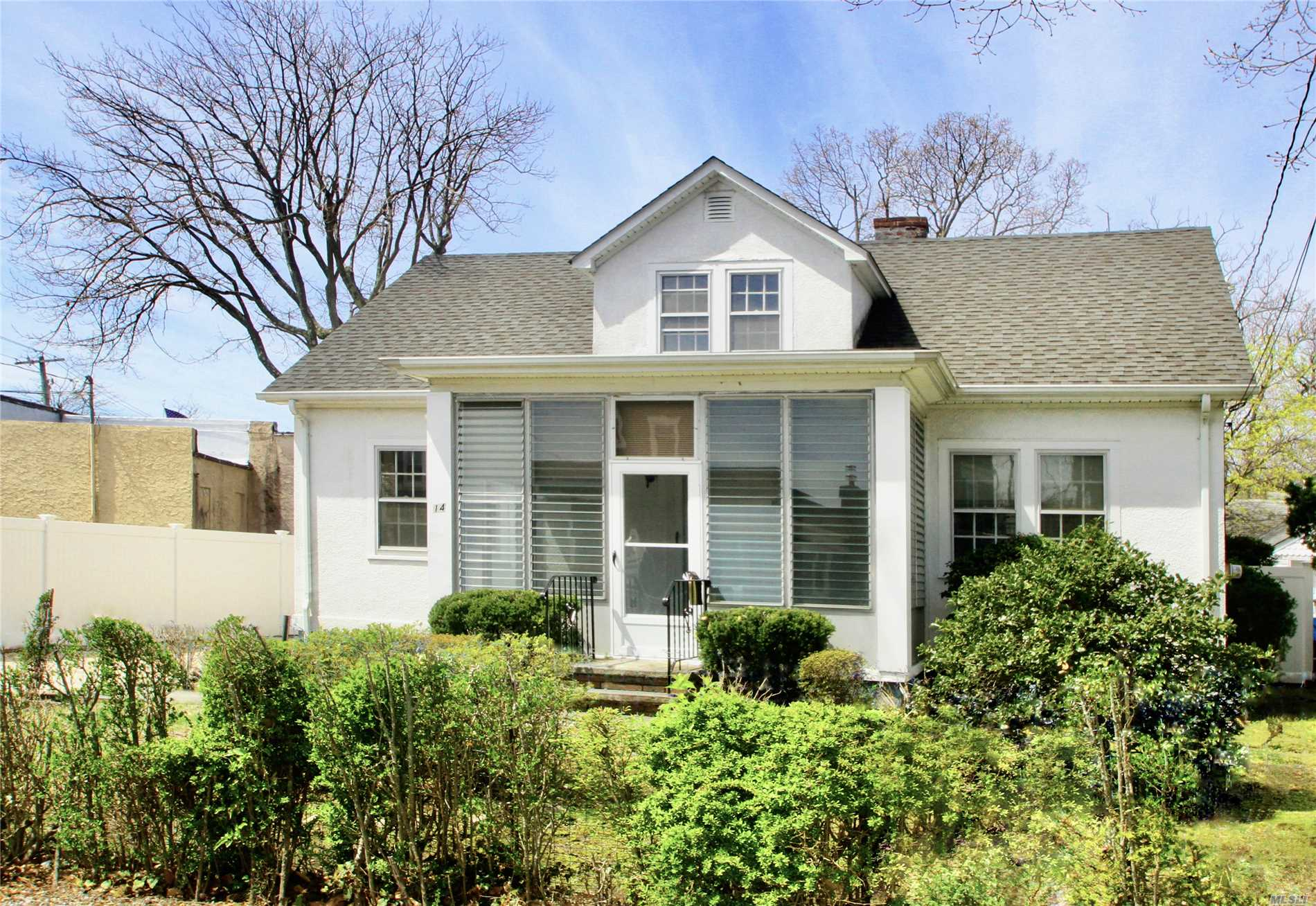 Charming 1920's 4 Bedroom 2 Bath Stucco Cape in Private Beach Community awaiting your finishing touches. Choose your kitchen countertop and design your dream bathroom. Enjoy the warm summer nights on the enclosed front porch and spend the cold winter nights in the living room in-front of the wood burning fireplace. This Home also features a formal dining room, full basement, second floor sitting area and laundry area, 2 car detached garage and access to Private beach in the heart of Bayville.