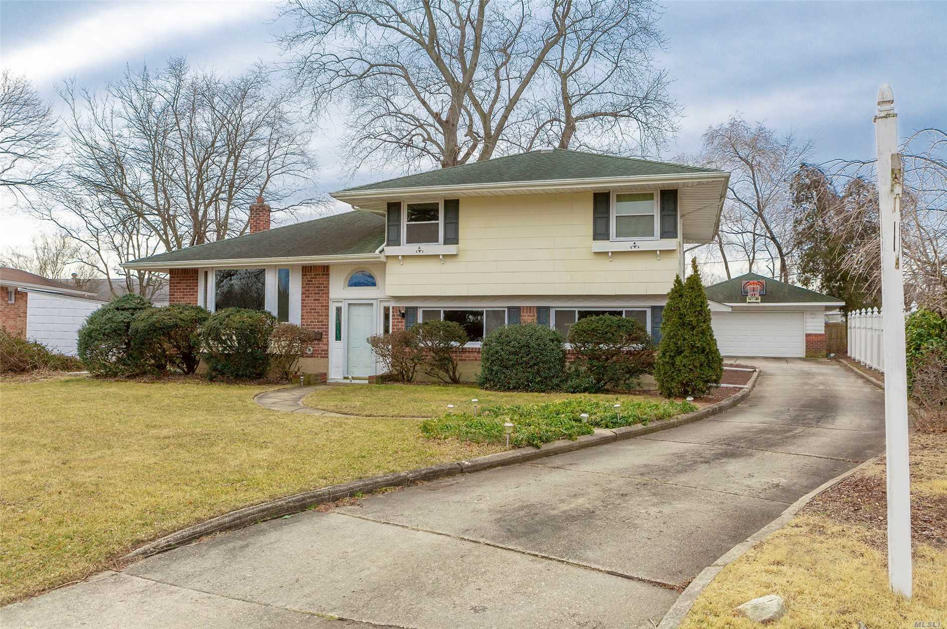Come and see this over-sized and meticulously maintained split. Features include open floor plan, EIK, DR, large living room, two full baths, family room, Florida room, basement, detached two car garage, gas cooking/heat, and new water heater. Conveniently located to shops and parkways. All this on a beautiful block in Commack schools. Hurry, wont last!