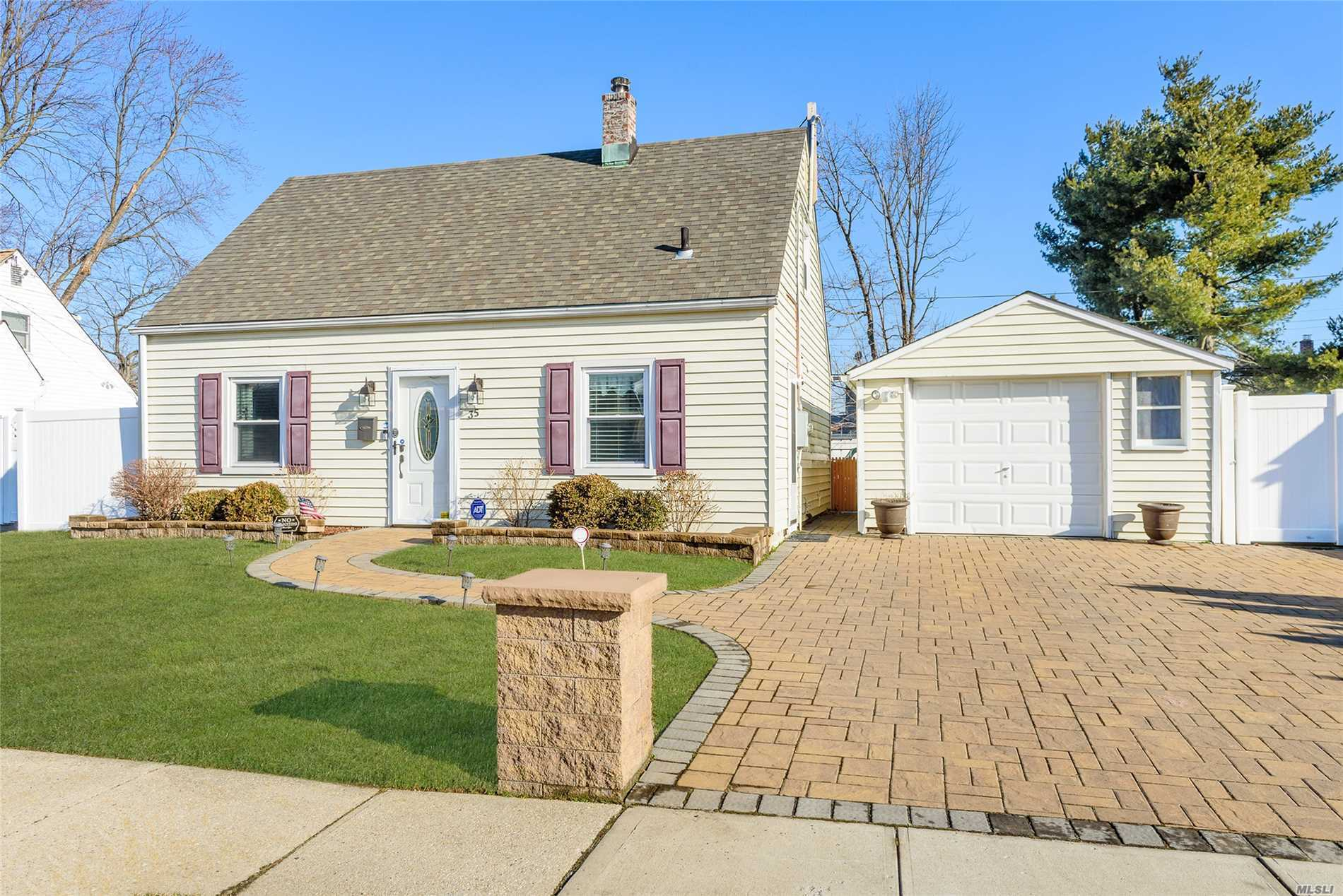 Fantastic 3 Bed Cape In Levittown For $409, 000. The Perfect Midblock Location With Amazing Curb Appeal. A Large Double Wide Pavement Driveway & Walkway, 1.5 Car Garage & Fully Fenced Private Yard! Boasting A New Kitchen W/ Stainless Steel Appliances, Ig Sprinklers, New Washer & Dryer, Updated Windows & Roof! Move Right In!