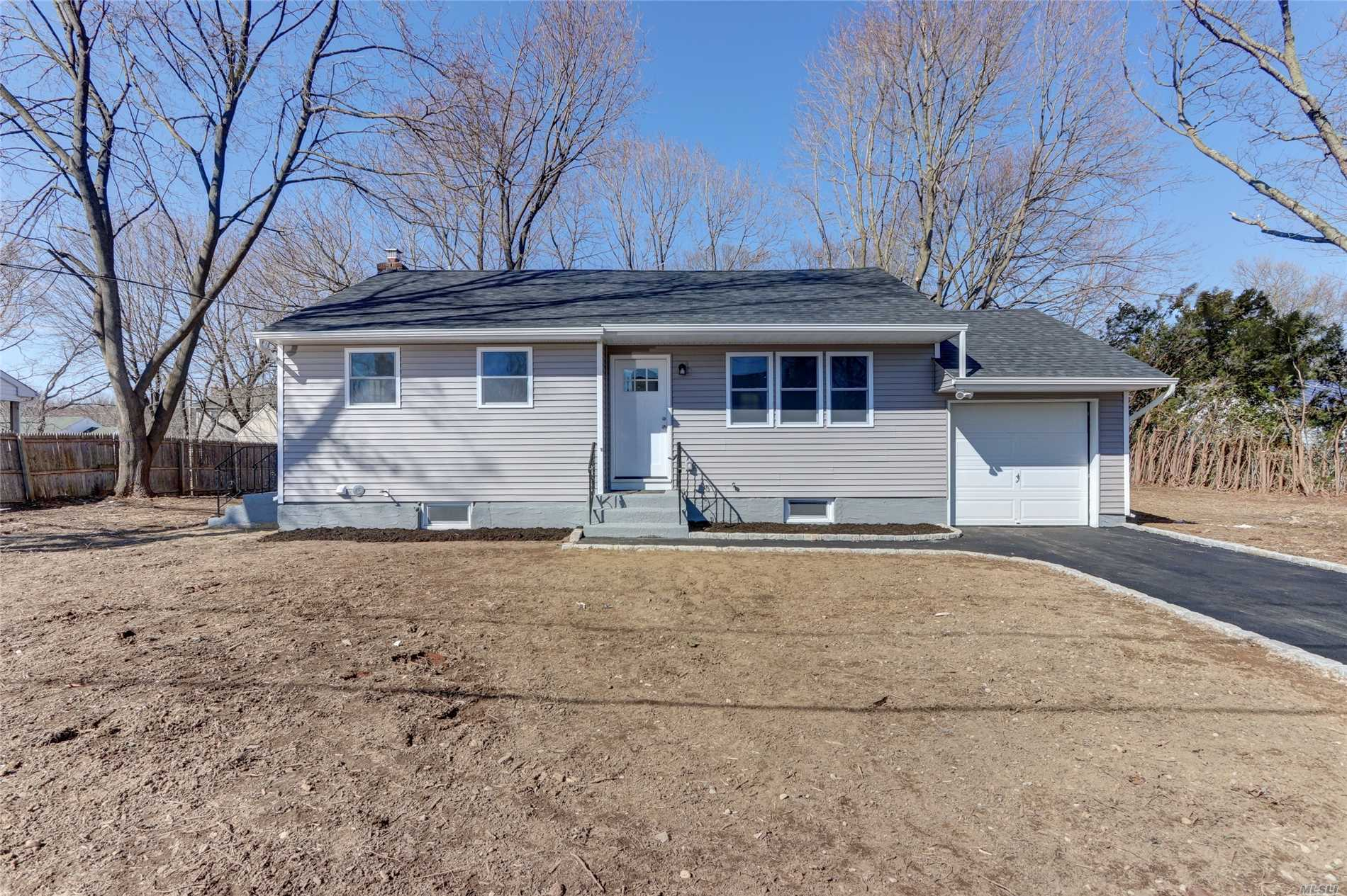 Totally Renovated Ranch - Full finished basement w/outside entrance. Everything New: Roof, siding, windows, electric, plumbing, boiler, kitchen w/granite & SS appliances. Over-sized lot w/new driveway. Worry free living, call today will not last!