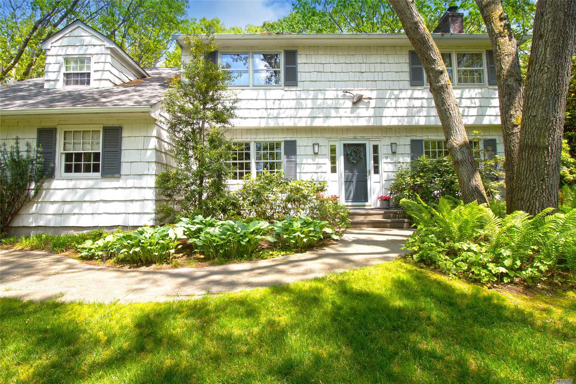 Classic four Bedroom Colonial just a stone's throw to West Meadow Beach. Gracious Living Room with fireplace, formal Dining Room, Den, Eat in Kitchen and Sunroom. Tucked away off the road on 1.36 private acres with mature Rhododendrons and Azaleas. Three Village Schools, Excellent value!