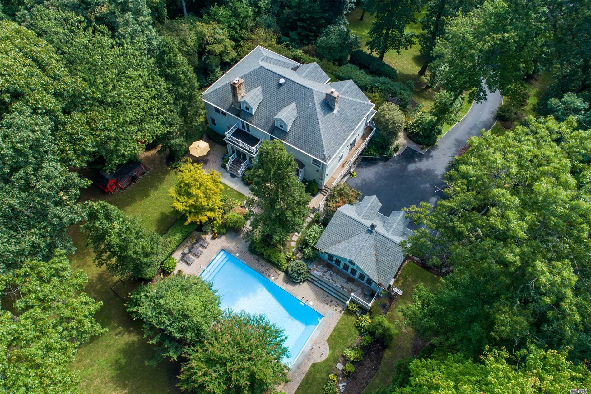 Exceptional Private Cul De Sac Location, Beautifully Updated and Appointed 5 Bedroom Colonial Backing Caumsett State Park. Rich with Moldings, Hardwood Floors, High Ceilings, and a Fabulous Open Floor-plan. Each Principal Room is Generous in Size with Many Details and Amenities. Enjoy Gathering in the Newer Kitchen with An Outdoor Entertaining Area. This Fabulous Setting has A Separate Pool House with Views to the Heated In Ground Pool and Flat Fenced Back Yard. Fiddlers Green Beach ( Dues)
