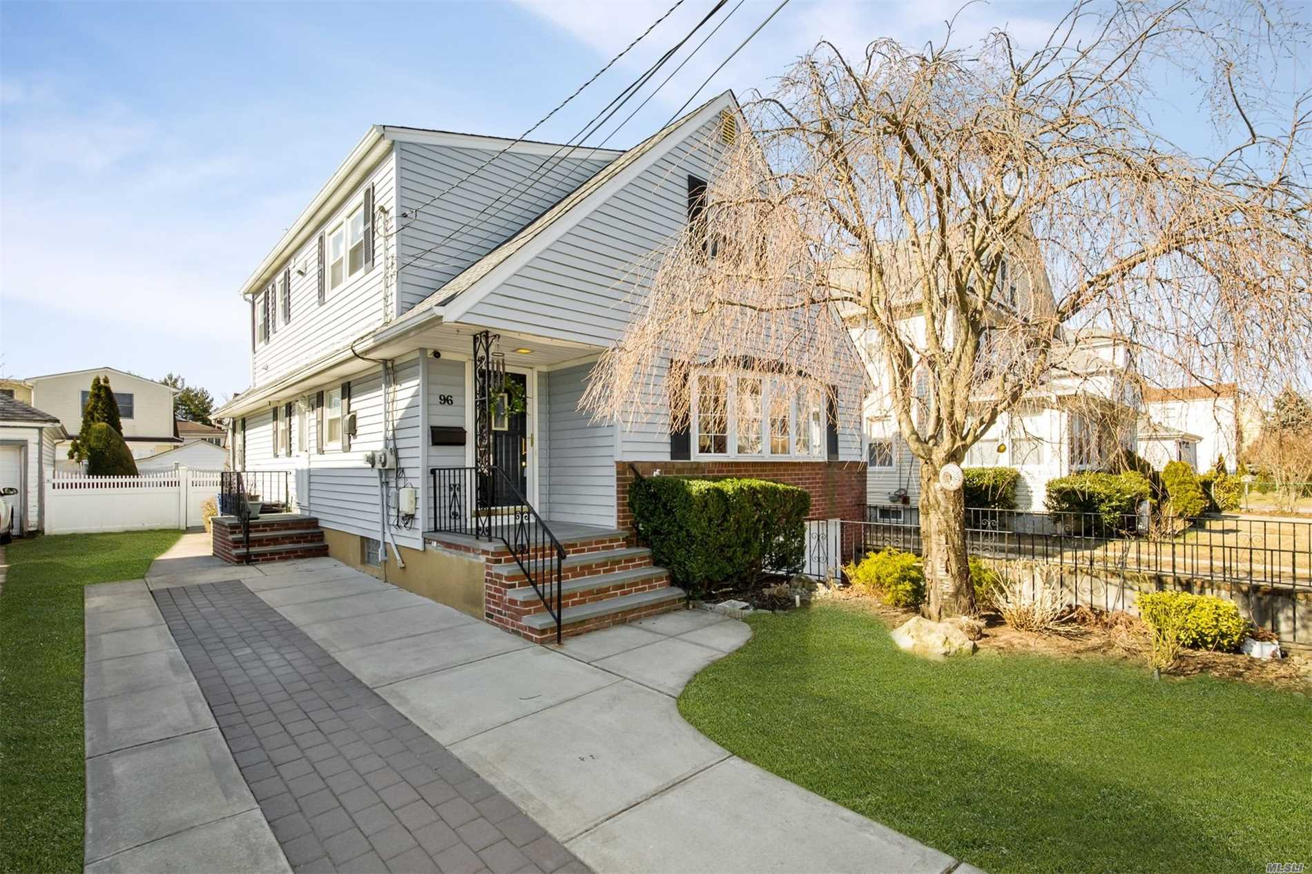 Don't Miss This Rare Opportunity to view this Beautiful and Very Spacious Home. This Home Offers 5 Bedrooms, 3 Full Baths, Wood Burning Fireplace With Hardwood Floors Throughout. This Home Has A Walk In Cedar Closet Along With Other Large Closets And Storage Space. This Is A Perfect Home For An Extended Family. Minutes From LIRR Or Bus To Queens. Possible M/D With Proper Permits.