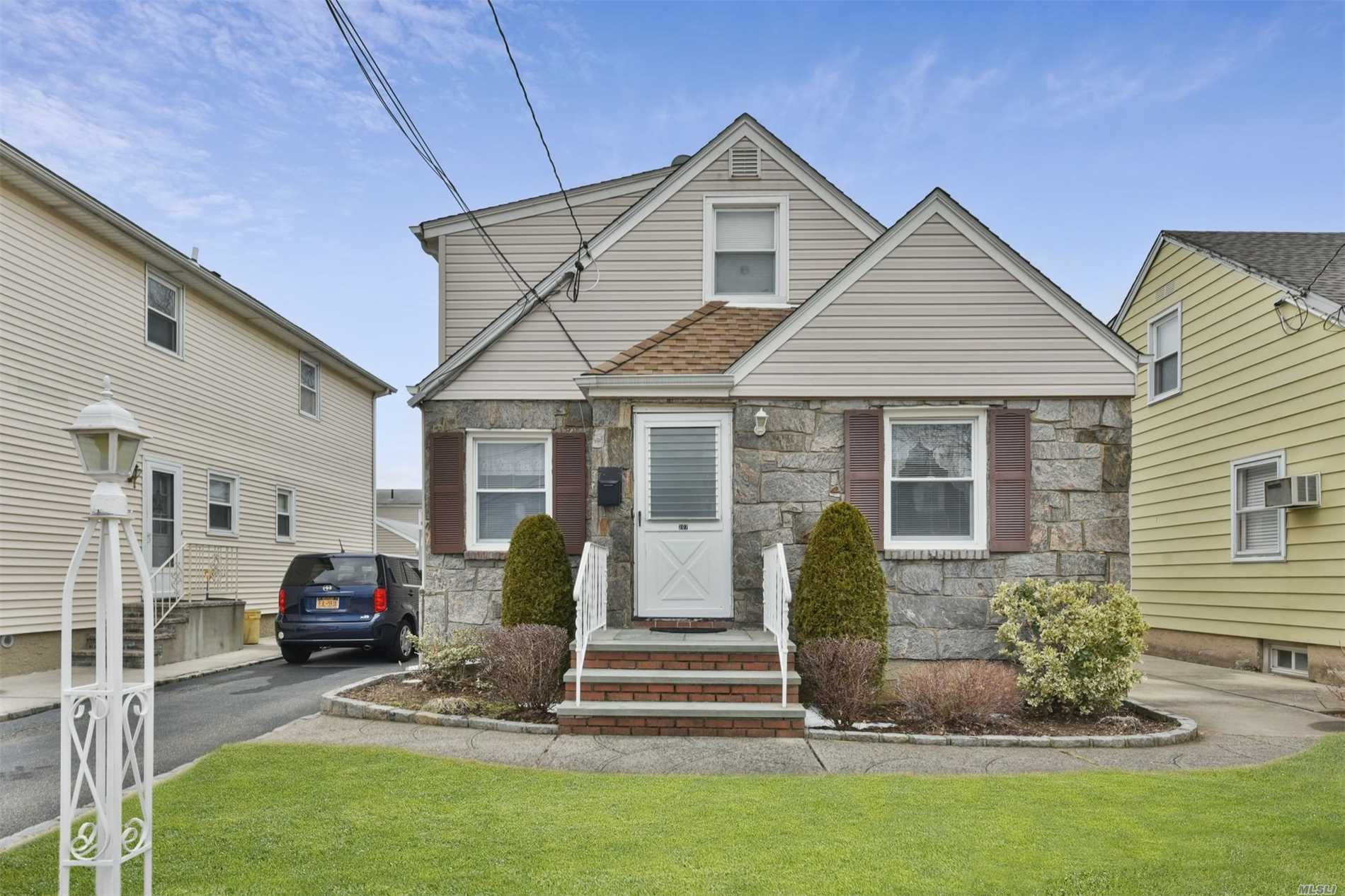 Well Kept Cape Home For Sale In Mineola, Full Side Dormer, 2nd Floor Can Be Made Into 2 Brs, New Gas Heating, Oversize Garage, Finished Basement, New 200 Amps Electric , All Replacement Windows.