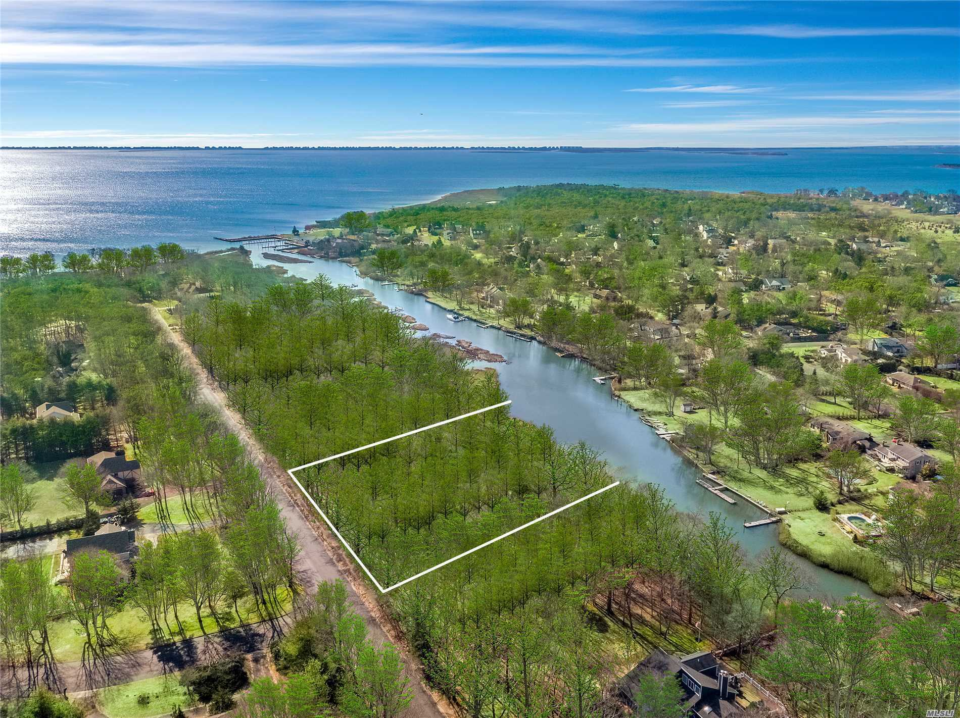 Build your waterfront dream home on this 2-acre wooded, overlooking Mattuck/Heils Creek. Located in the desirable Baywood subdivision in East Moriches, offering the opportunity to build up to a 10, 000 sq.ft. 2 story home with deep water dock. Current permits in place from the NYS DEC. Home owner's association includes private beach & dock access. Call for more information.