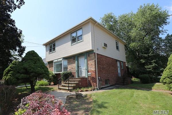 Beautifully Maintained Brick/Vinyl Colonial With Spacious Living Space On Corner Property In Best Location In Bayside. Beautiful Hardwood Floors Throughout & Nat Gas. 3 Bdrm/1.55 Baths. Bsmt W/ Sep Entry, 1/2 Bath And Plumbing Sep Garage & Pvt Drvway. Close To Public Transportation, Lirr, Highways, Shopping, Parks & Blue Ribbon Schools! Don't Miss This Opportunity - It Won't Last Long!