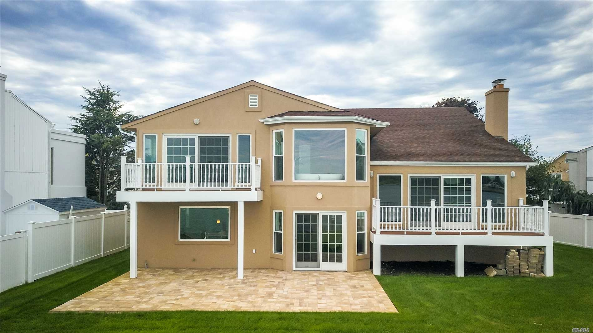 Welcome To Your Permanent Vacation Home! Breathtaking Waterfront Views In A Private Cul De Sac On The Best Block In The Neighborhood! Better Than New, Gut Renovated, Only Thing Left Is The Foundation. Sprawling Open Layout W/ Chef's Kitchen, Designer Bath's, Waterfront Views On Every Floor!! Brand New Bulkhead, Builder Spared No Expense. Close To Schools, Parks, Restaurants, Shopping, & Much More! Must See!!