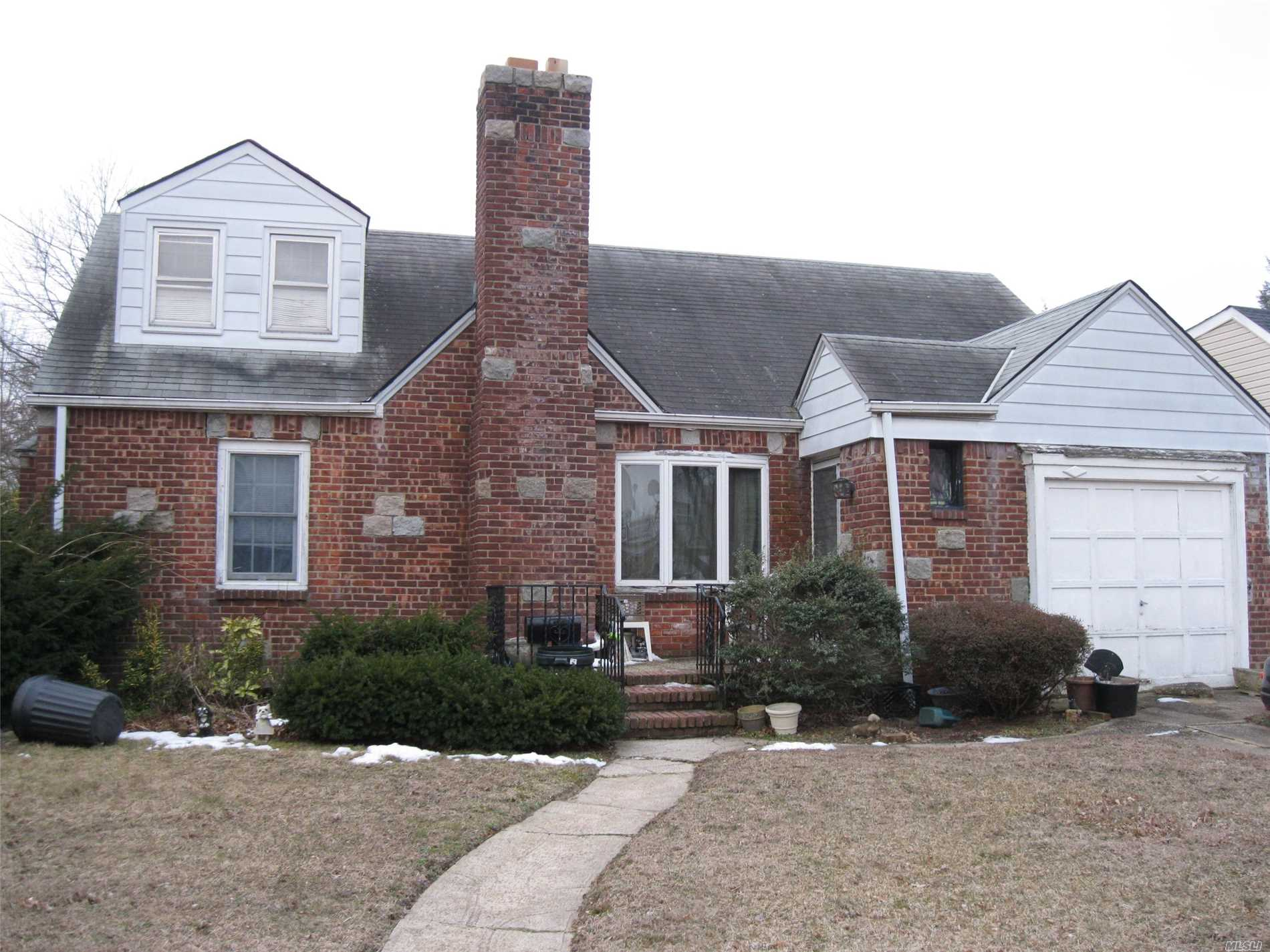 Home Needs Extensive Cleanout and Repairs and/or Rebuild. 4 Bedroom, 2 Bath Cape in West Hempstead. Minutes from Shopping, Highways and Schools.