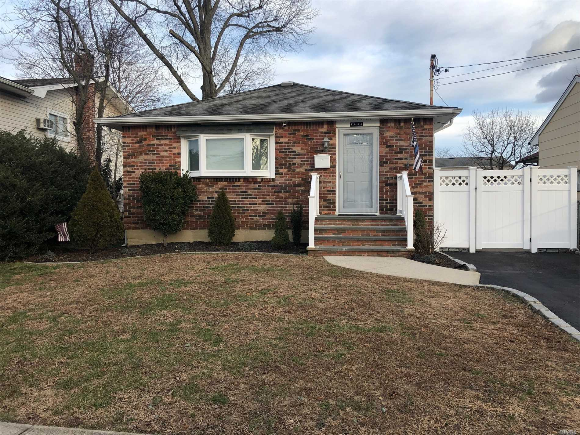 Mint Ranch, Move in Ready!! Updated Kitchen with Black Stainless Appliances. New Windows, Doors, and PVC Fence. Efficient home with solar panels. 200 Amp Electric, Hardwood Floors, Hi Hats Galore, Gas and Oil in the house, Brick & Bluestone Stoop. Walk To Park This Home Is Larger Than It Appears And All Rooms Are Nice Size. Priced To Sell! No Flood Insurance Required!!