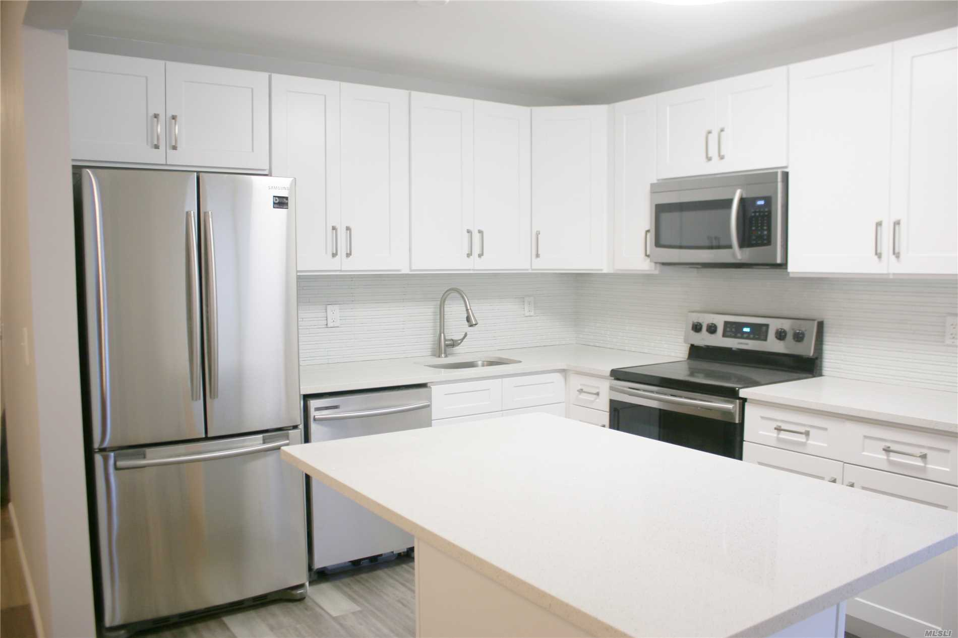 All New! Tranquil & Private Village Retreat: open & airy, fully updated & upgraded main floor Unit (no stairs) welcomes you w/an open floor plan, large living space w/walk out private patio, opens to formal dining room & new eat-in kitchen w/quartz island. King-size bedroom inc. multiple closets/large walk in. Unit boasts plenty of sunlight, abundant storage, new bath, In-suite Washer/Dryer hookup, private parking spot & private outdoor storage. Walk to village, LIRR, Bethpage Park.
