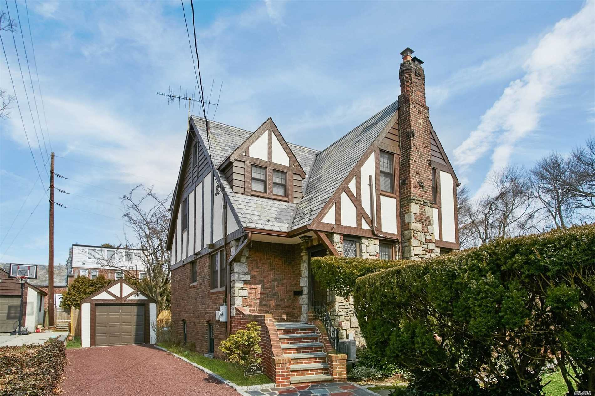 Location, Location, Location.. This Traditional Tudor Located At The End Of A No Through Street Block Boasts Large Rooms With Tons Of Natural Sunlight And Hard Wood Floors Throughout. 1st Floor Features A Living Room W/Fireplace, Dining Room, Eat-In Kitchen, Season Room And Full Bath . Second Floor Features Master Suite W/Full Bath, 2 Addt'l Bedrooms. Finished Basement With Bonus Space. The Outside Park Like Grounds Is A Rare Find And Great For Entertaining!!