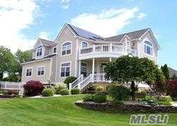 Diamond Colonial home with GORGEOUS, unobstructed views of the Great South Bay. Beach Access across the street. This house has everything including Solar Panels, Navien Hot Water System, Central Air, Whole House Generator, Central Alarm, Camera System, LED Lighting, Fire Place, Jac Tub, Outside Shower, Green Features and more! Everything has been undated and maintained, Nothing to do except move in and Enjoy your Cop of Coffee on your Bay View Veranda!