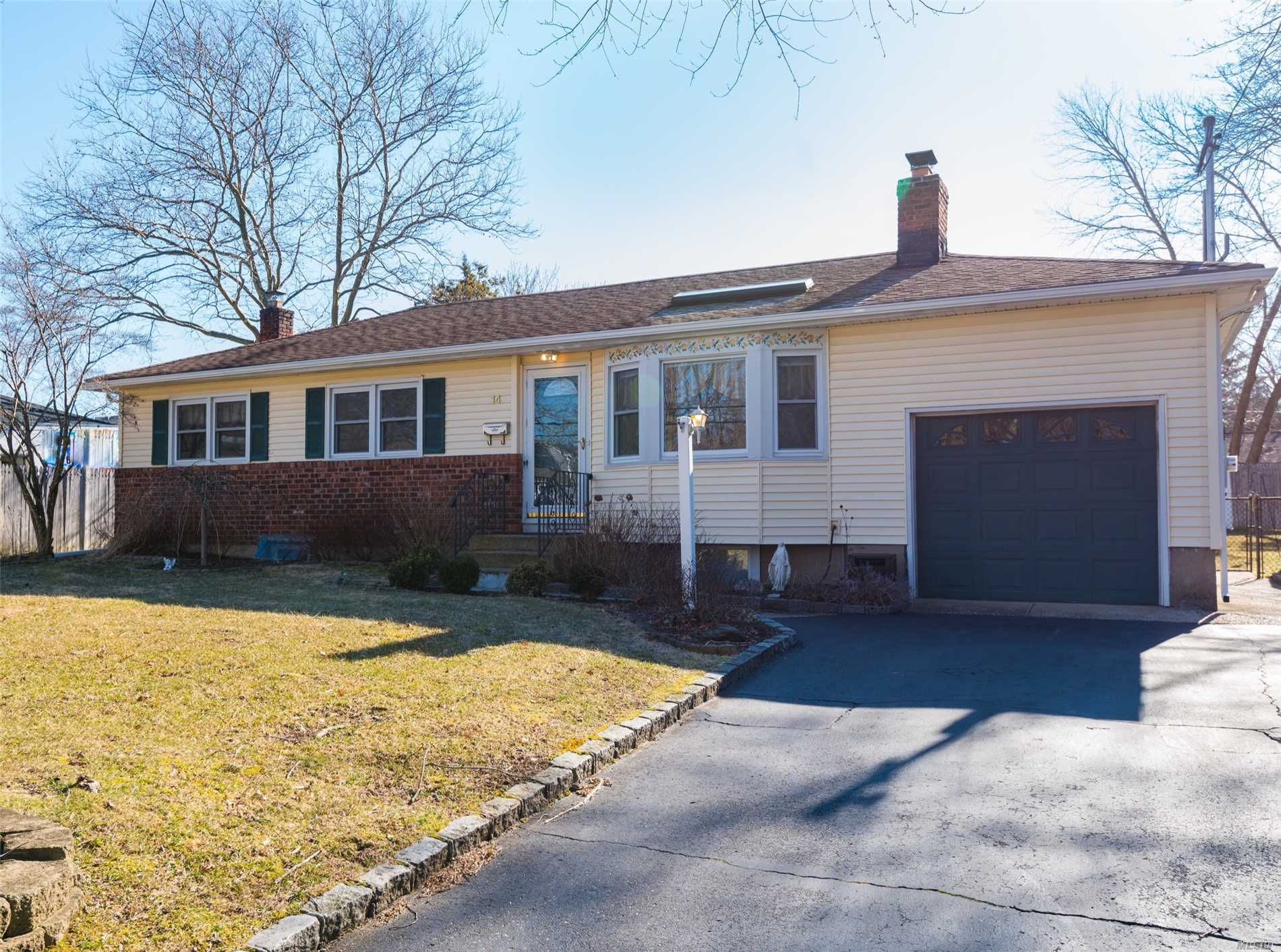 Lovely 3 Bedroom / 1 Bath Ranch in the Elwood School District. Features a Large and Inviting Living Room with Skylight and Wood Burning Fireplace. Great Flat Fenced-in Backyard with Large Patio.