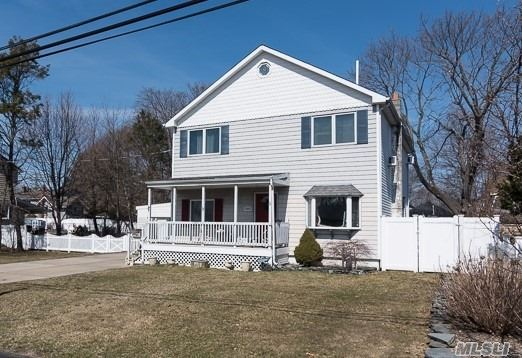 Beautiful lg center hall Colonial w/front porch, situated on a quiet block, in prestigious HHH SD#5. Lg EIK, Maple Cabinets, Siles stone countertops, S/S appliances, lg rear ext LR/Great Rmw/vaulted ceiling, banquet FDR. 2nd Fl 3 master size BRS, 2 updated FBths, huge attic, most windows replaced, 200 AMPS, 2 car att gar, oversized park like prop, 100X143, multi level deck.