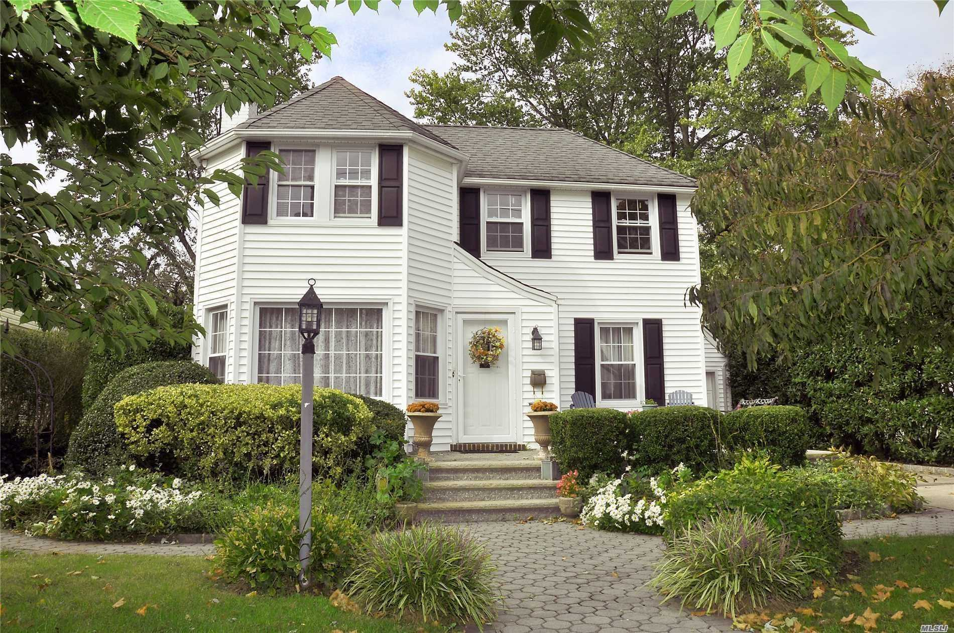 Classic Colonial In Prime Stewart Manor Location! Inviting Entrance Foyer, Oversized Living Room With Fireplace, Banquet Dining Room, Eat-In Kitchen, Cozy Family Room. Large Entertaining Deck. Two Blocks To Shops, Bars, Restaurants. Five Blocks To The L.I.R.R. And The Stewart Manor Country Club.