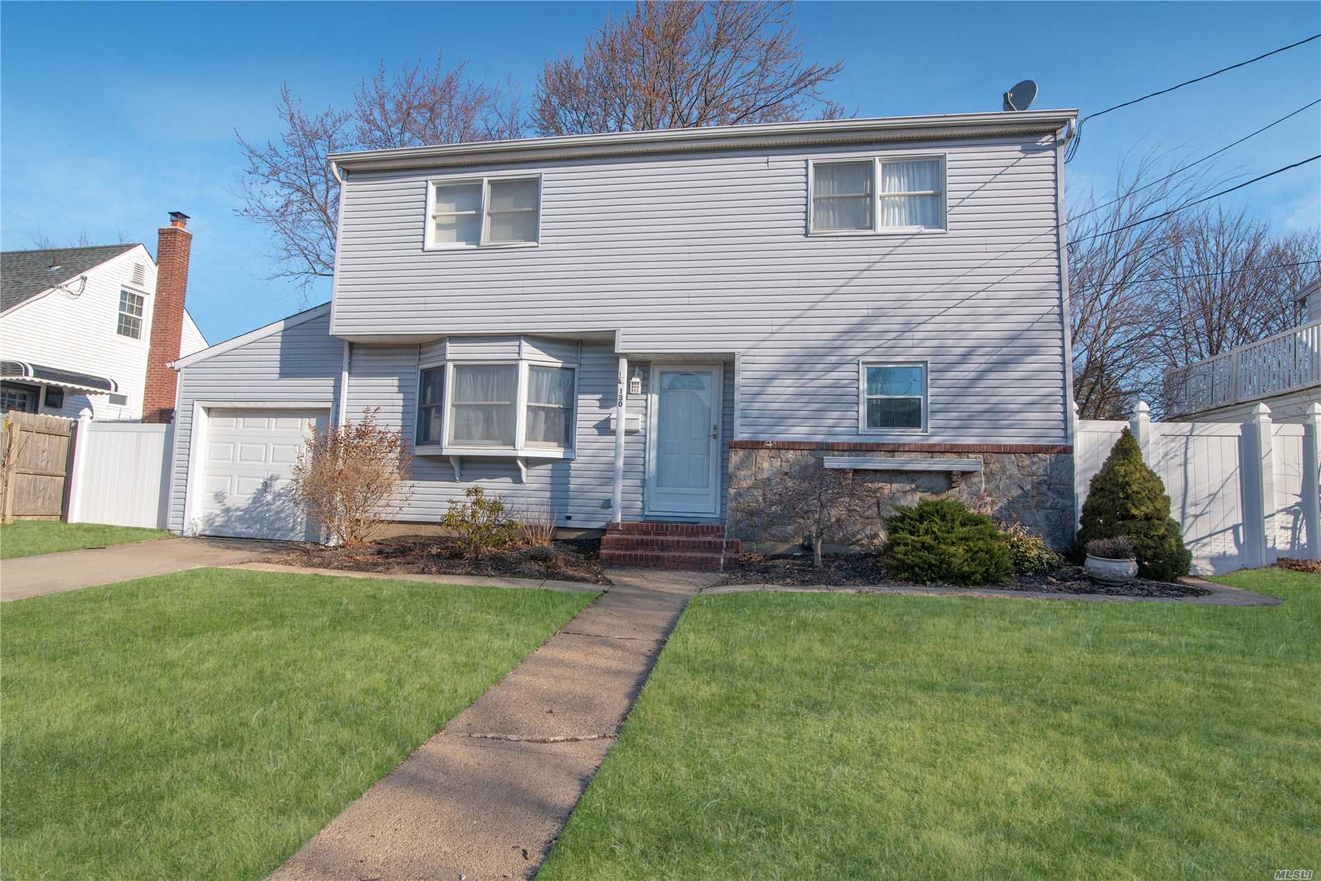 (photos to follow) Pretty & Desirable 5 Bedroom & 2 Bath Colonial in Island Trees SD# 26. Newer Kitchen, LR, FDR, Beautiful HW Floors, 5th Bedroom on 1st FL Optional Office/Den/Playroom. Huge Basement with Great Possibilities, Lots of Storage, Fantastic Property/Exterior, Central Air Conditioning, American Home Shield 'One Year Warranty' INCLUDED!