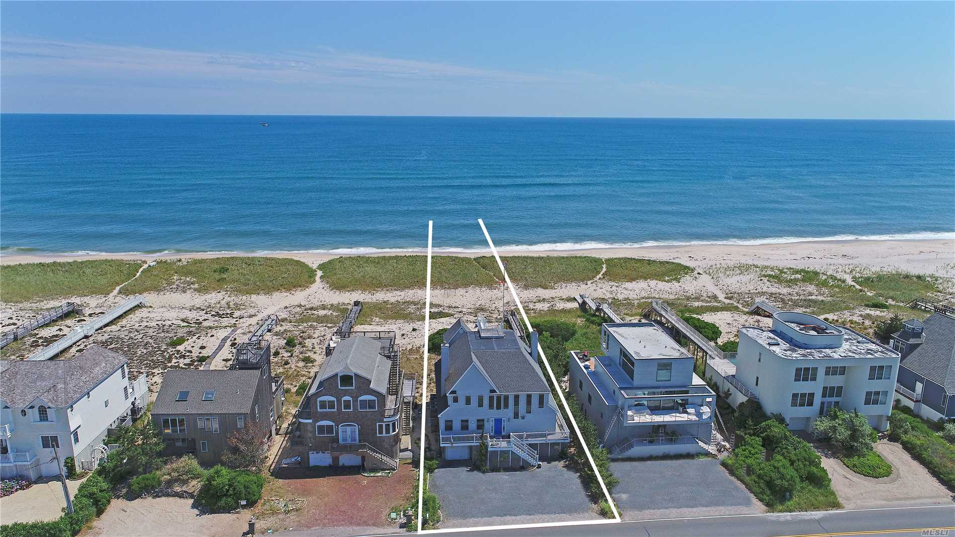 With expansive water views in all directions you'll never want to leave your oceanfront retreat. Turn-key postmodern home with low maintenance exterior & wrap around porch which allows access to all points of the home and the beach. The first floor offers three bedrooms, two baths, den/family room, laundry, elevator, & oversized master suite with oceanside porch, & full en-suite bath. Up the stairs your find the main living space with ocean views and large decking area, family room with fireplac