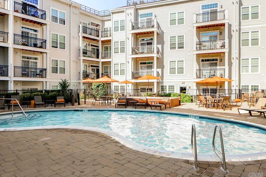 Hempstead. Massive 1600 Sq.Ft. 3 Bedroom/2 Bath Apartment Featuring A Gourmet Kitchen W/Granite Counters & Stainless Steel Appliances, Over-Sized Bath, Walk-In Closets, Washer/Dryer, & Balcony. Building Amenities: In-Ground Pool, Outdoor Fire-Pit & Bbq Areas, Fitness Center, Resident Lounge W/Gas Burning Fireplace & Full Kitchen. Minutes From Finest Shopping & Dining. Very Close Proximity To Lirr!