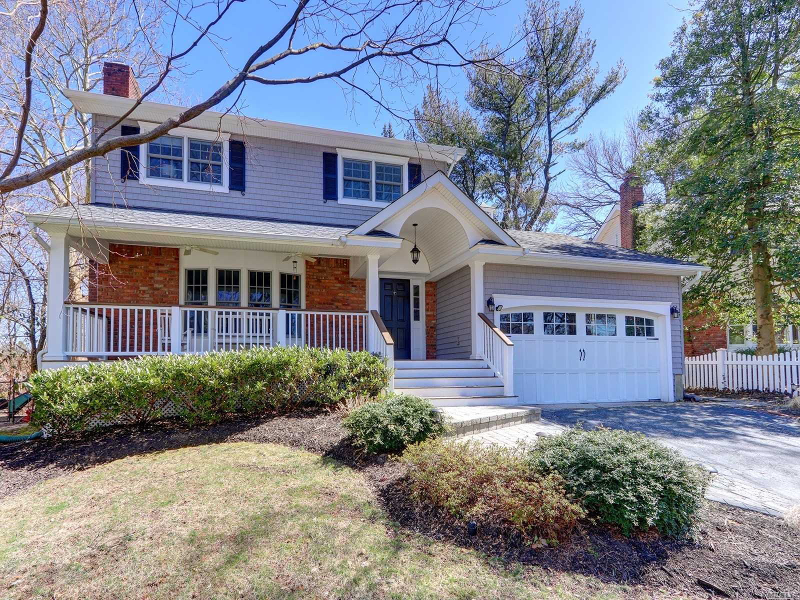 Beautiful Mint+ Colonial w/front porch, .20 flat acre/usable property on cue-de-sac in the highly acclaimed and sought after Harborfields SD#6! Master w/new bath, new granite EIK, formal dining room or Den, Family room with wood fpl and white crafted mantle, double pane Andersen windows, ductless mini split CAC, IGS, new shed, wood floors, crown molding, full bsmt, 2 car garage.Minutes from Cntrprt, Npt, & Hntngtn Villages-all with its charm, fine restaurants, boutique shops and beaches!LIRR/NYC/1HR