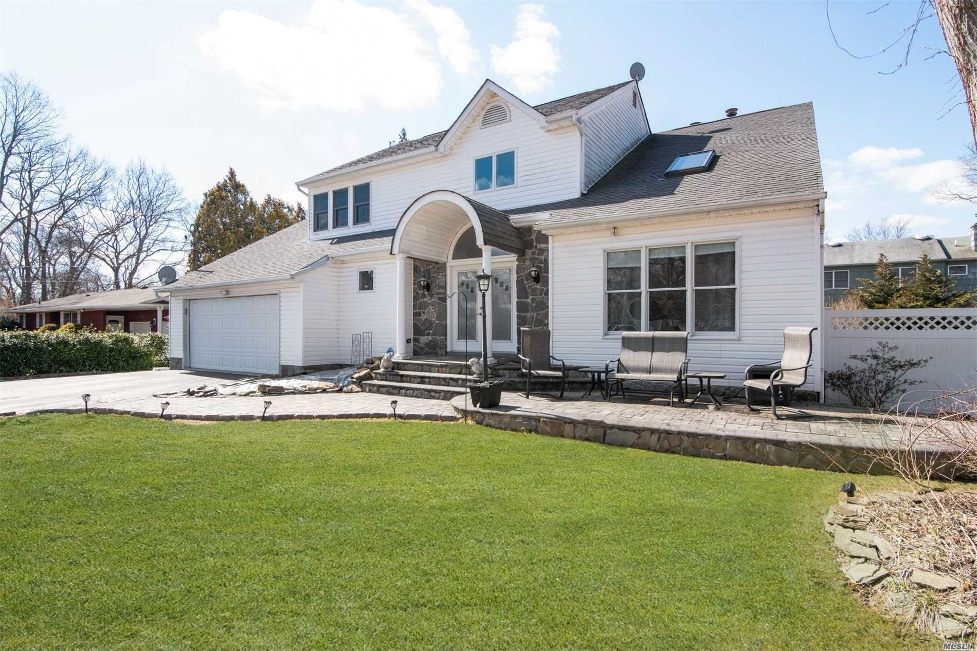 Beautiful sun drenched, airy Contemporary Colonial w/spacious rooms & layout, Newly painted & updated flooring thruout, 2018 CAC, 2016 Furnace & Hot Wtr Htr, Large Kitchen w/plenty of cabinets & pantry. A formal dining rm & a Great Den w/updated stone fireplace. Upstairs is a Large Master Bedrm w/ WIC & private ba. Laundry on Ground Flr. Two sets of glass sliding doors lead to backyd oasis w/semi-inground pool surrounded by firepit, stonework & benches. Large deck for BBQs. Koi Pond included.