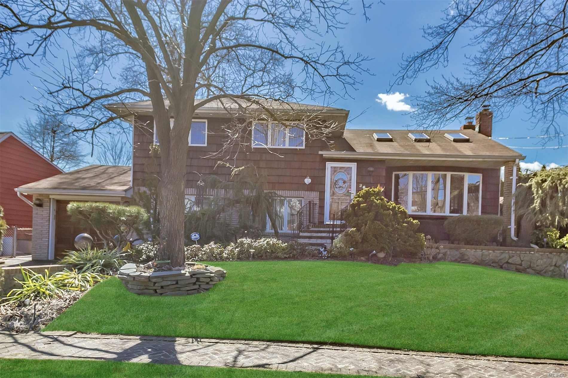 Spacious Split Mid Block Location, Featuring 4 Bedrooms, Bright Bonus Rm w/Fireplace, Huge Eat In Kitchen, Hardwood Floors, Fireplace In Basement Too, Large Cedar Closet, French Doors to Outside Entertainers Delight Backyard featuring Water Fountain, Dead End Street, A Must See!