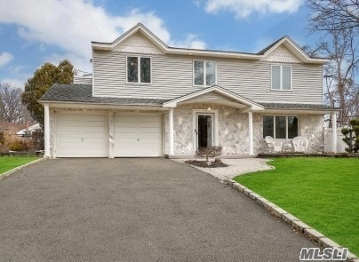 Home Features 4 Bedrooms, 2.5 Baths, Yng Granite EIK, Large Entry Foyer, FDR, Den w/Fireplace, Large FLR w/Doors to Back Deck, Finished Bsmt. Other Features Include Heated Salt IGP only 8yrs young, Beautiful Pavers plus side Basketball Court for the Kids. CAC, 200 AMPS Service, Transfer Switch for Generator, Updated Roof, Replaced Cesspool, Stone/Vinyl Front, Extra Wide Driveway for Parking 4 Cars and 2-Car Garage. Taxes $11, 811 in Desirable Smithtown Schools