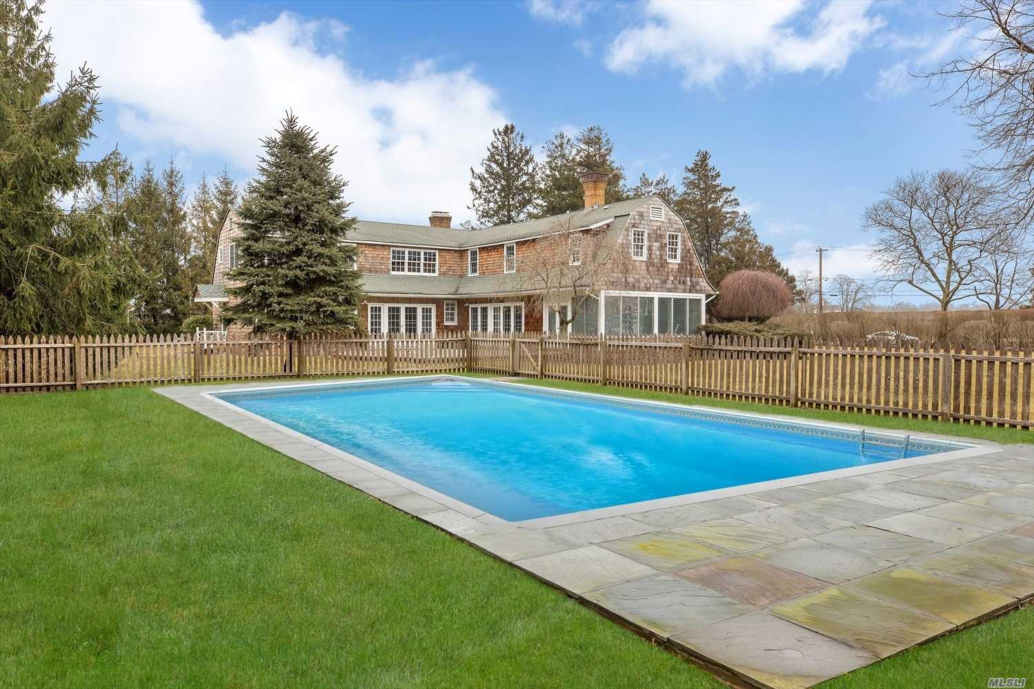 Spectacular New Renovations. This Beach Home is located right in the heart of the Village. 4 En-Suite Bedrooms make for the perfect rental. Chef's Epicurean kitchen, Great Room, Living Room, Sunroom, Formal dining room and everything is new. Full Basement, 3 car garage. Lavish Stone Patio, Gunite Pool, Waterview and Lush Landscaping make this a private oasis. Very Accessible to town with its theaters, resort shops, cafes, restaurants and the Gorgeous white sandy Rogers Beach