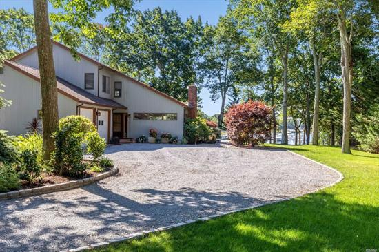 Newly renovated home with a deep water dock made to secure a 50 foot Yacht on the Mattituck Inlet. New pilings, Trex Decking, Fresh Water and Electric at dock. Majestic views of Sunsets. Private Park like settings, home elevated on Hill, Huge Master Suite(24 by 17) has deck with commanding views, Family room with gas fireplace, Living room with wood fireplace. Newish Cherry Wood kitchen, 2 car garage, Heated Greenhouse and oversized shed over 1.05 acres. Owner's financing available.
