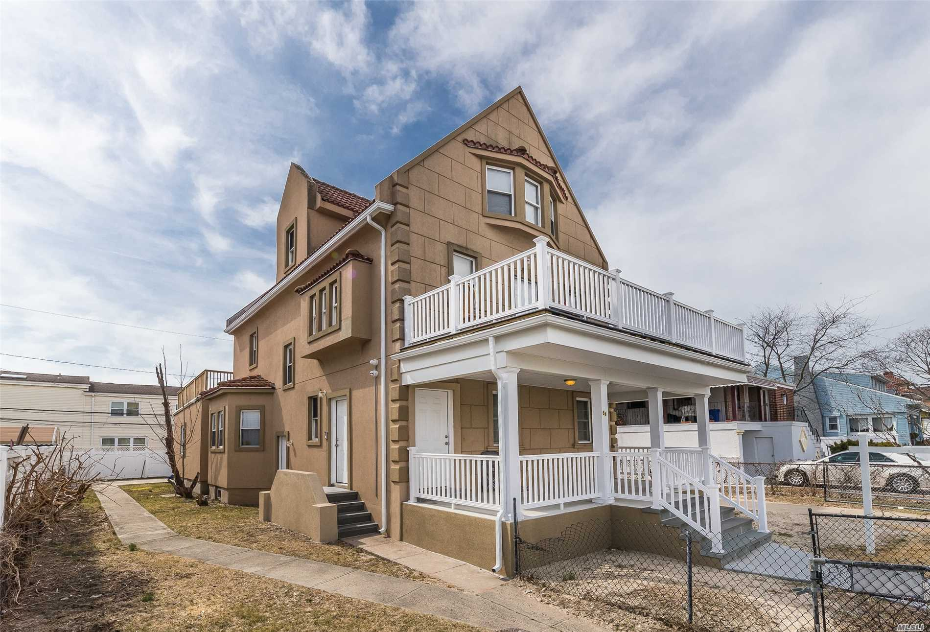 Beautiful, Airy, All new Bathrooms and Kitchens, Spend your summers sitting on a covered porch or on an upper breezy open porch. Steps from LIRR, 55 minutes from Manhattan, Have your tenant pay the majority of your mortgage. House is currently rented generating $7, 500 a month income.