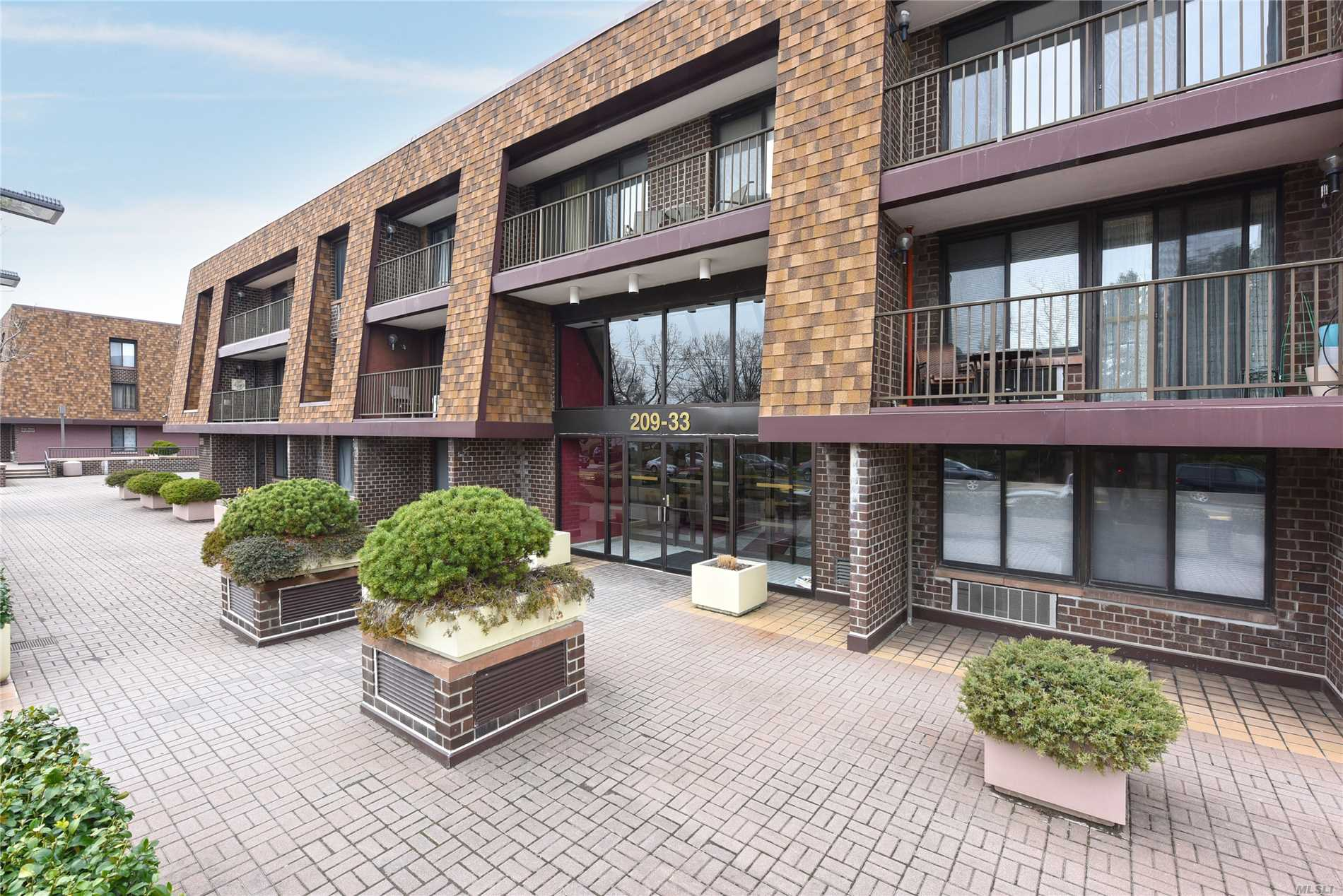 Sunny and bright corner condo for sale. Hardwood floors and washer and dryer in unit. This apartment has large closets. Common charges include water, parking spot in garage, storage room etc. Enjoy indoor/outdoor swimming pool & gym in the Fitness & Tennis Centers and Much Much More!! Express and local bus on the corner. Steps to the Bay Terrace Shopping Center.